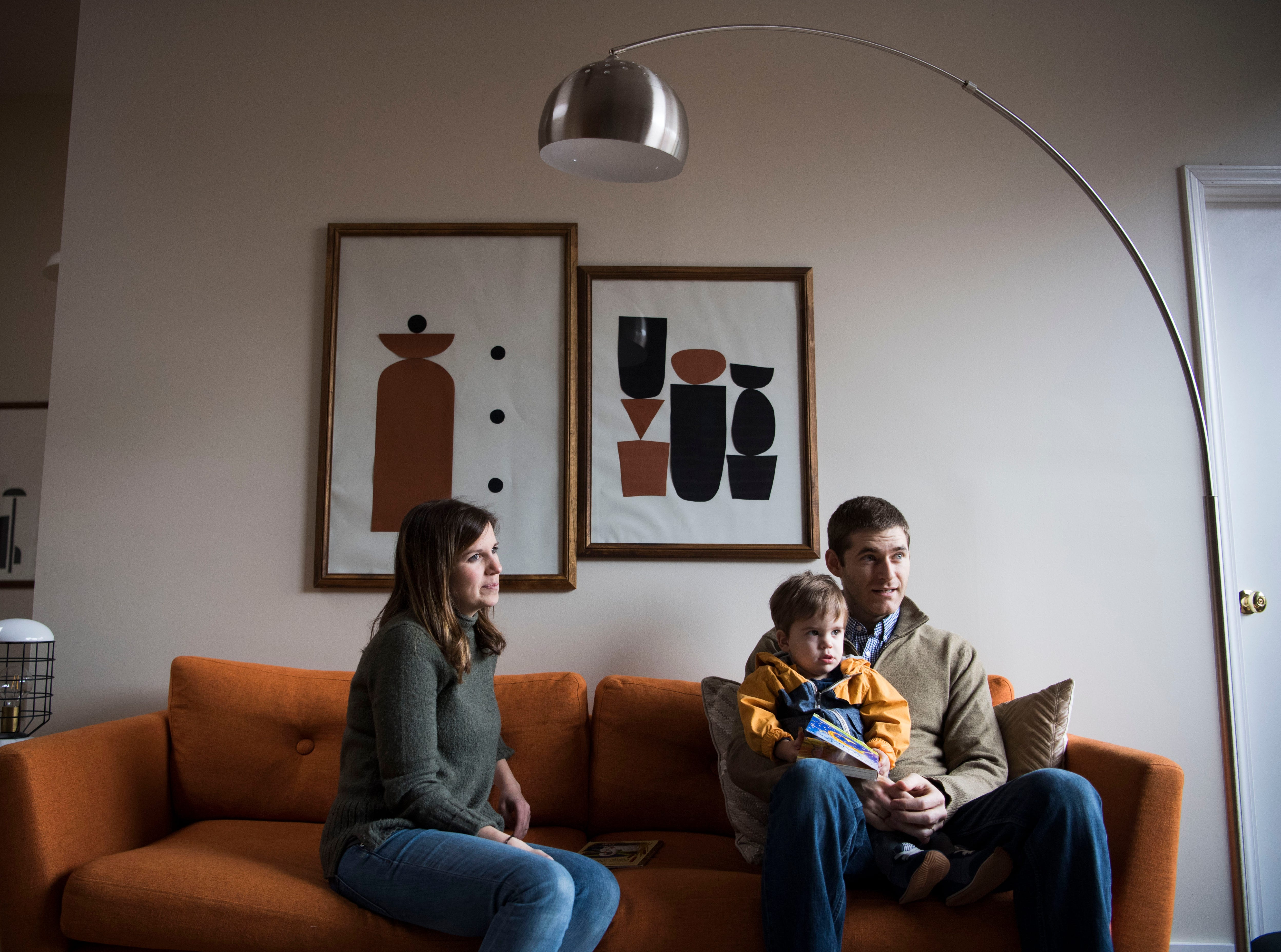 Suzanne Robinson sits with her husband Dylan and 21-month-old son Pete at one of 14 short-term rental properties the couple manages in their company Knox Staytion, in Old City Tuesday, Feb. 5, 2019.