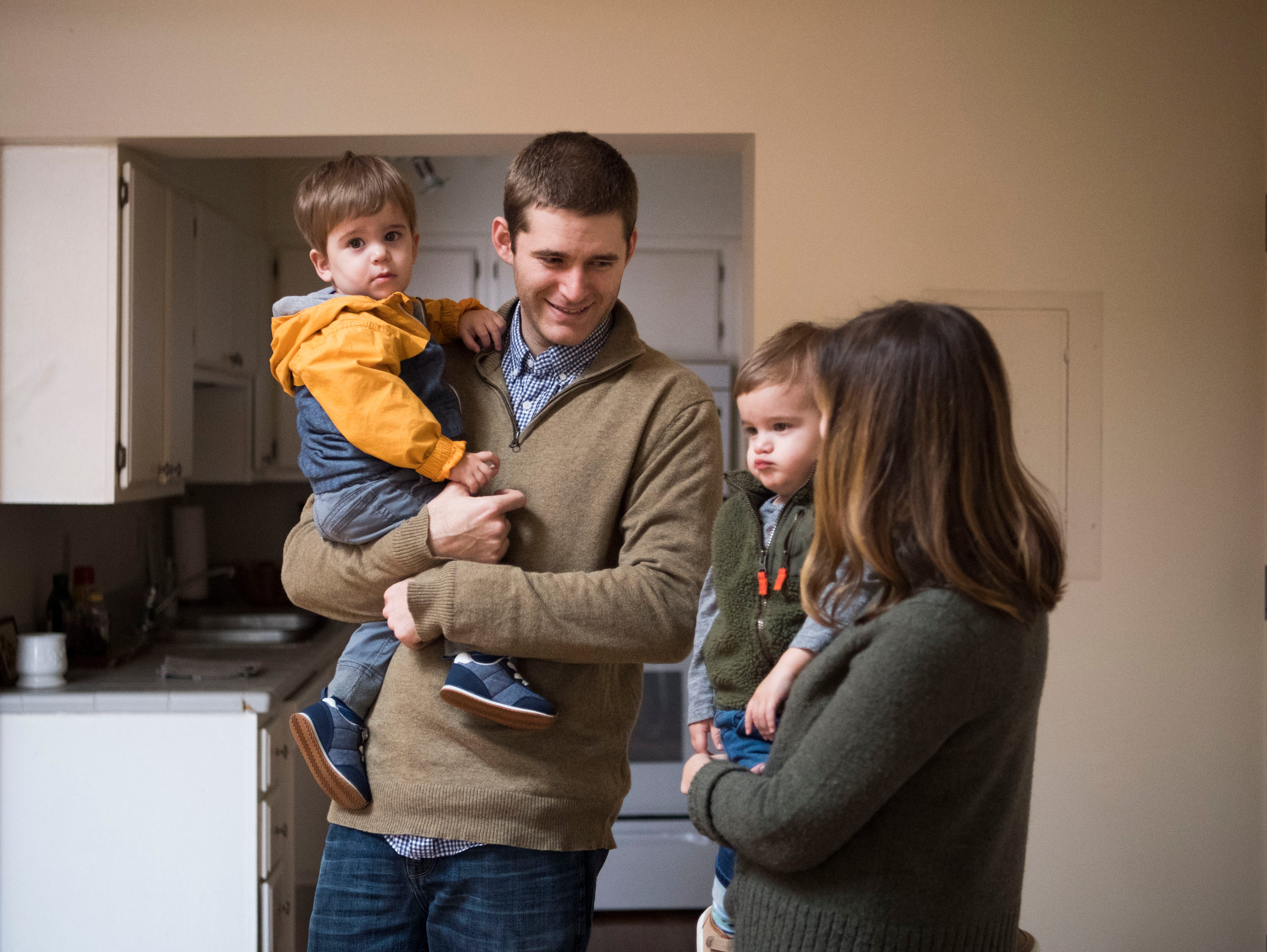 Dylan and SuzannevRobinson stand with their 21-month-old twin sons, from left, Pete and Duke, near the dining area in one of 14 short-term rental properties the couple manages in their company Knox Staytion, in Old City Tuesday, Feb. 5, 2019.