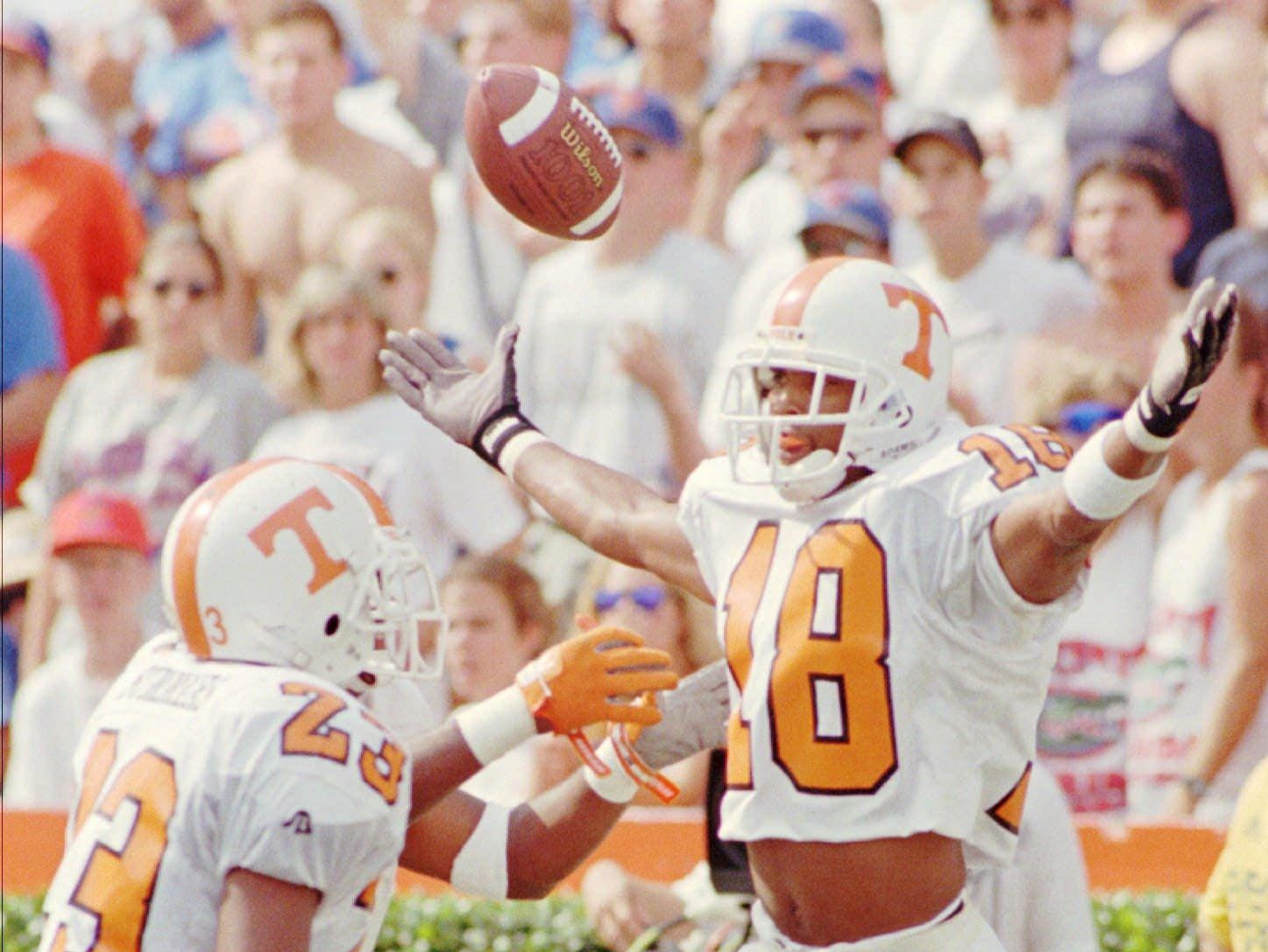 Tennessee's DeRon Jenkins (18) flips the ball into the air after scoring during the first quarter against Florida Saturday afternoon Sept. 16, 1995 at Florida Field in Gainesville as Tennessee's Shawn Summers (23) helps celebrate.