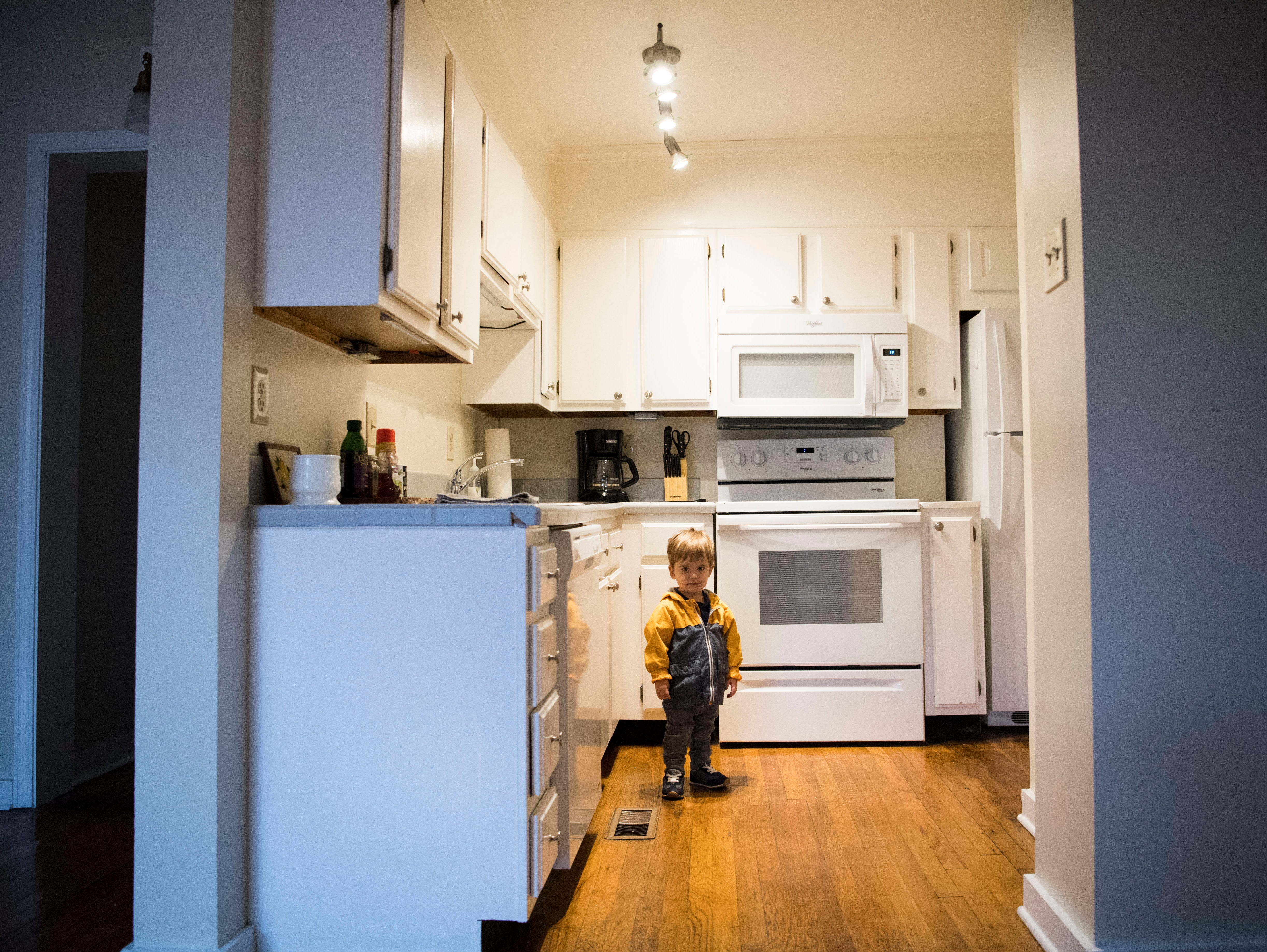21-month-old Pete Robinson stands in the kitchen of one of 14 short-term rental properties his parents Dylan and Suzanne Robinson manage in their company Knox Staytion, in Old City Tuesday, Feb. 5, 2019.