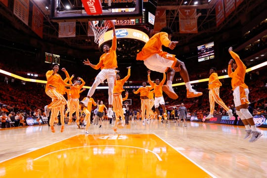 Tennessee's Jalen Johnson dunks while his Volunteer teammates leap around him before facing West Virginia on Jan. 26 at Thompson-Boling Arena.