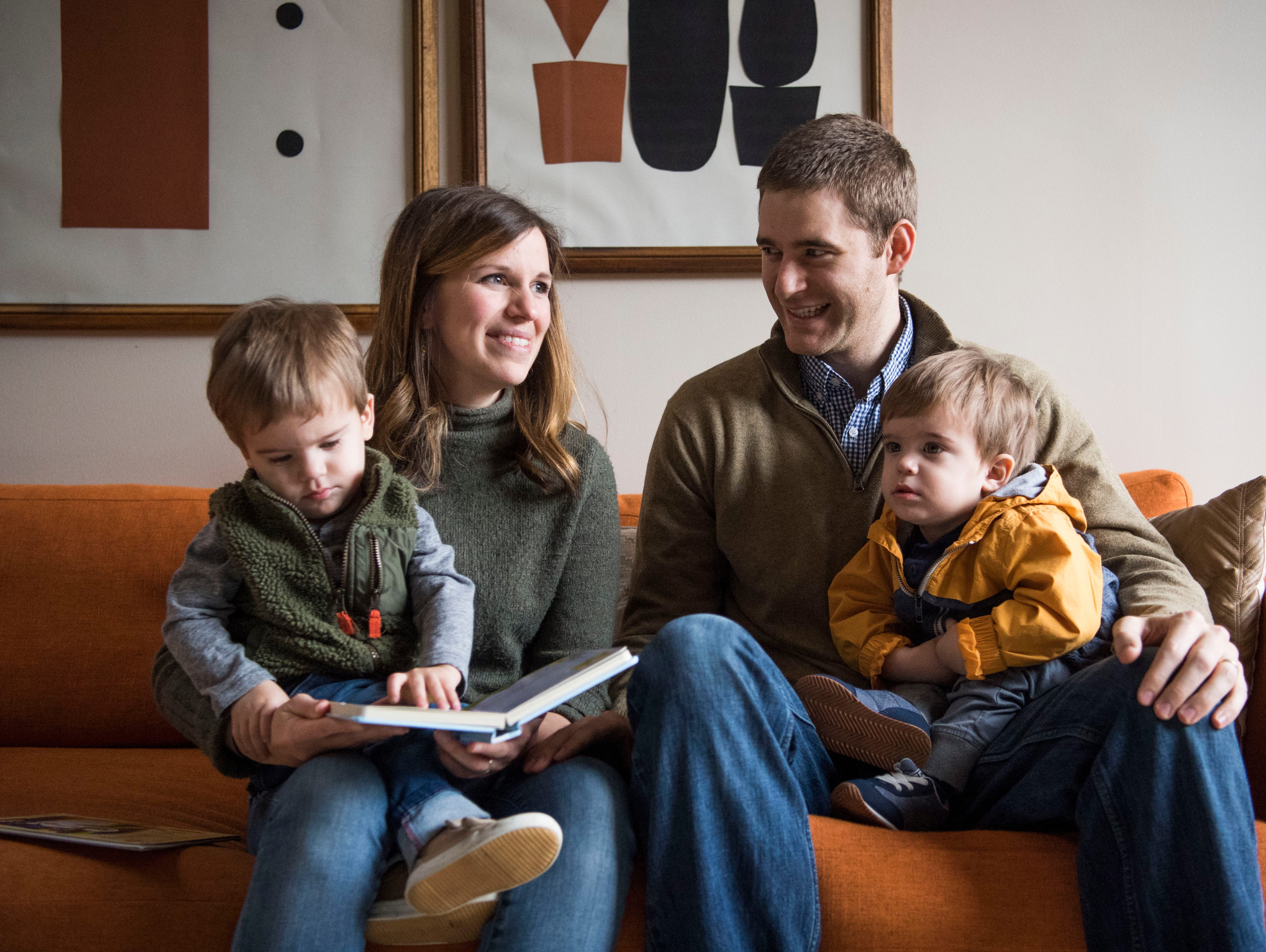 Suzanne and Dylan Robinson sit with their 21-month-old twin sons, from left, Duke and Pete, at one of 14 short-term rental properties the couple manages in their company Knox Staytion, in Old City Tuesday, Feb. 5, 2019.