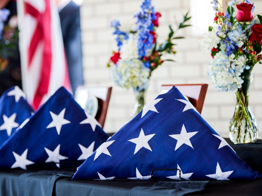 Folded flags were presented for each of the seven veterans buried during a military memorial service at the East Tennessee Veterans Cemetery on Tuesday.