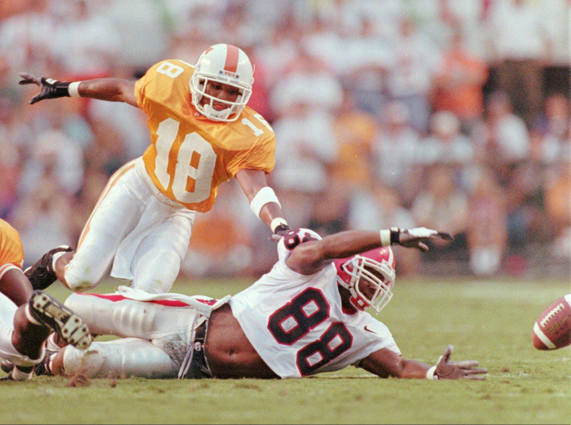 -  -Georgia's Brice Hunter (88) dives in vain for an incomplete pass as he is defended by Tennessee's DeRon Jenkins (18) during their game in Knoxville, Tenn., on Saturday, Sept. 9, 1995. (