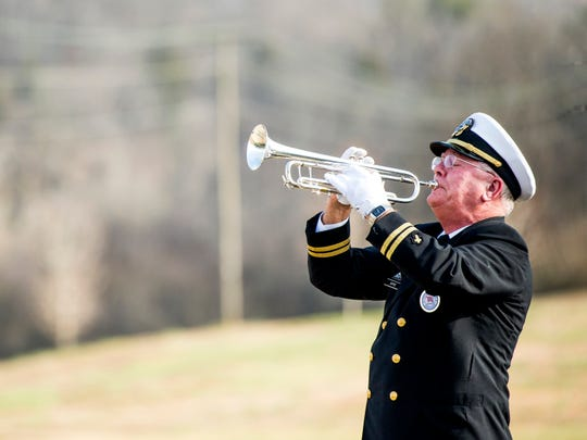 "A trumpeter plays ""Taps"" during a military memorial service for seven veterans held at the East Tennessee Veterans Cemetery on Tuesday."