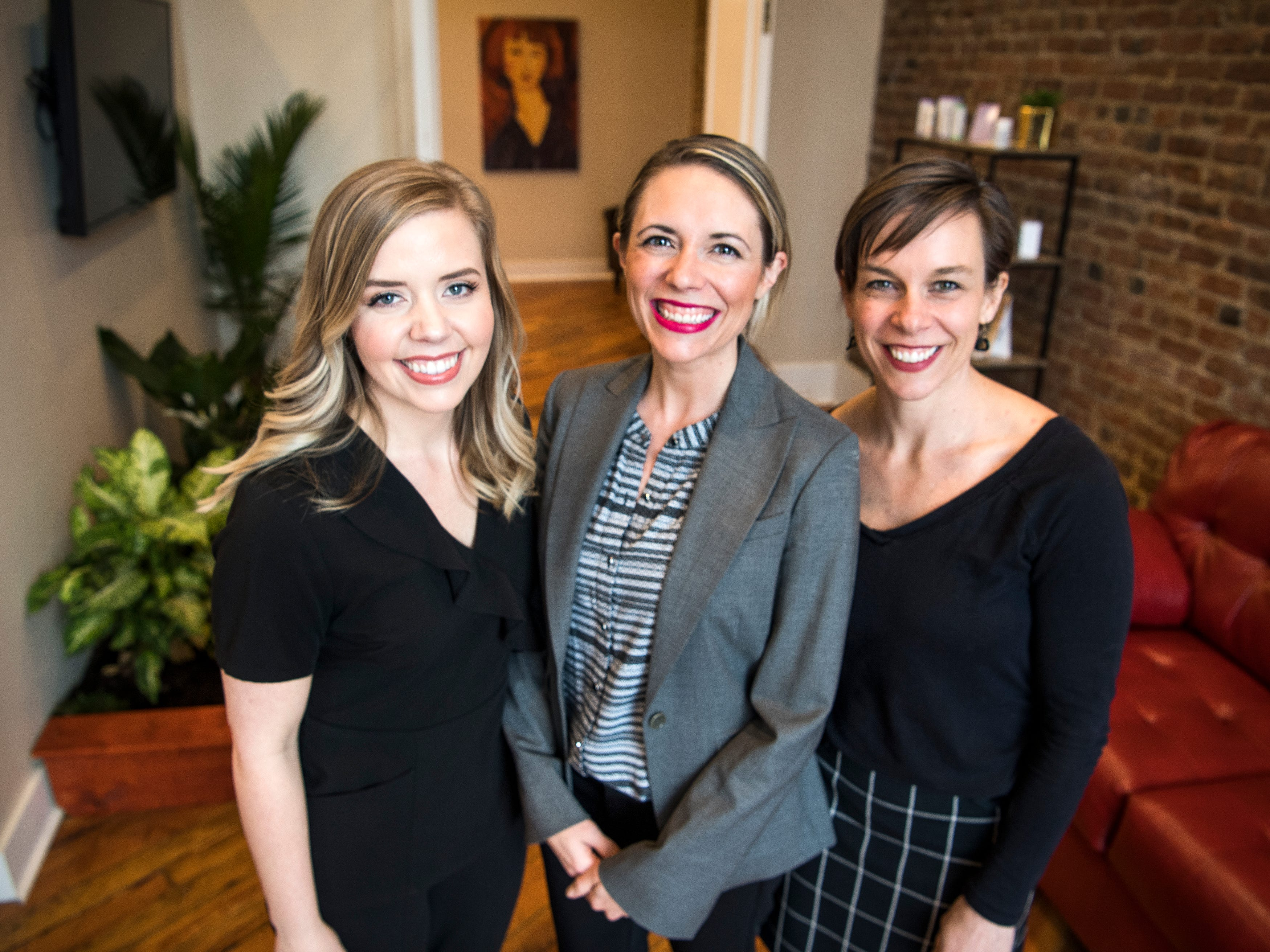 Mahala Brien, left, Ashton Byrne and Jessica Etheridge work at Old City MedSpa in downtown Knoxville.