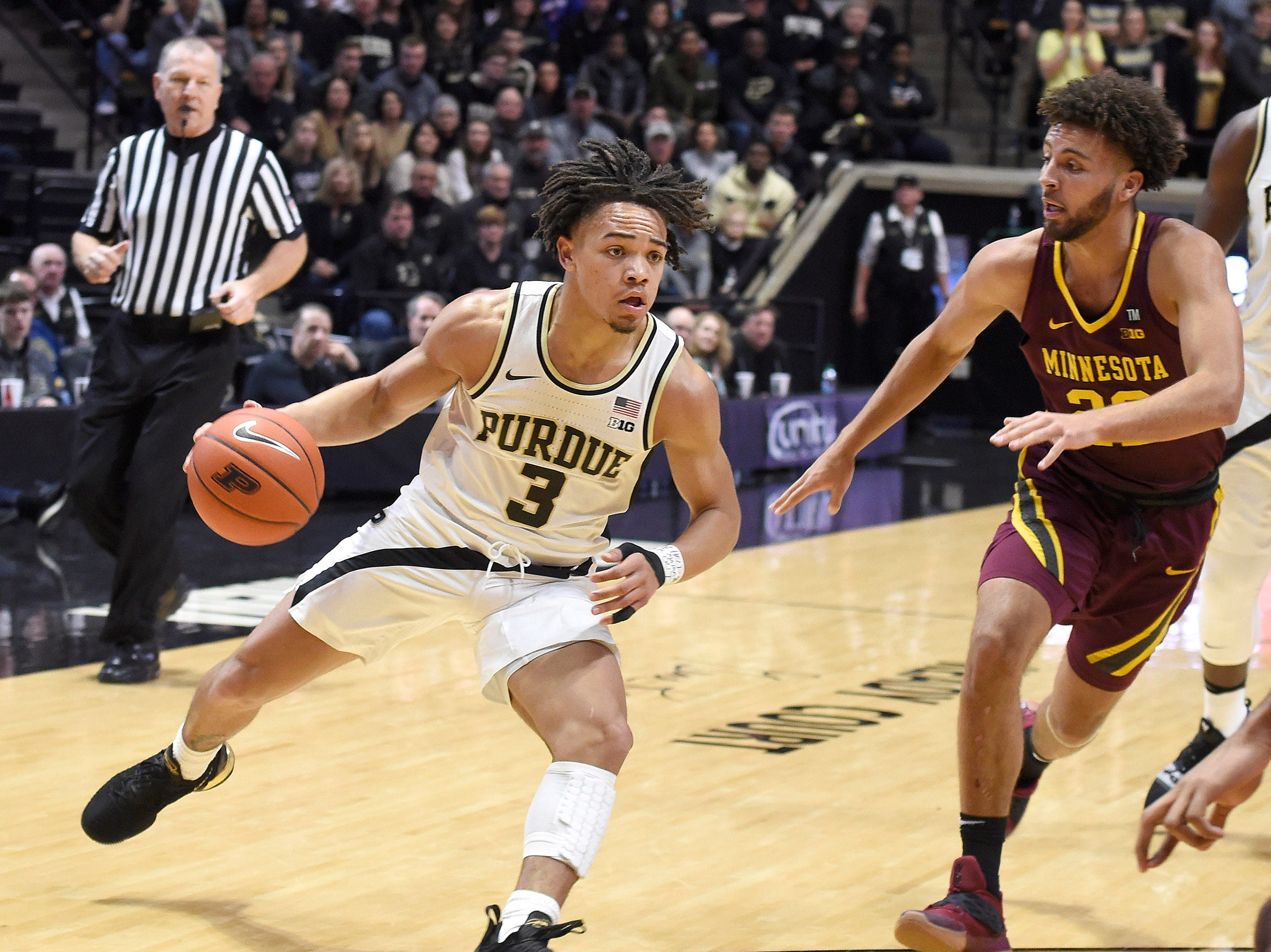 Feb 3, 2019; West Lafayette, IN, USA; Purdue Boilermakers guard Carsen Edwards (3) dribbles the ball around Minnesota Golden Gophers guard Gabe Kalscheur (22) in the first half at Mackey Arena. Mandatory Credit: Sandra Dukes-USA TODAY Sports