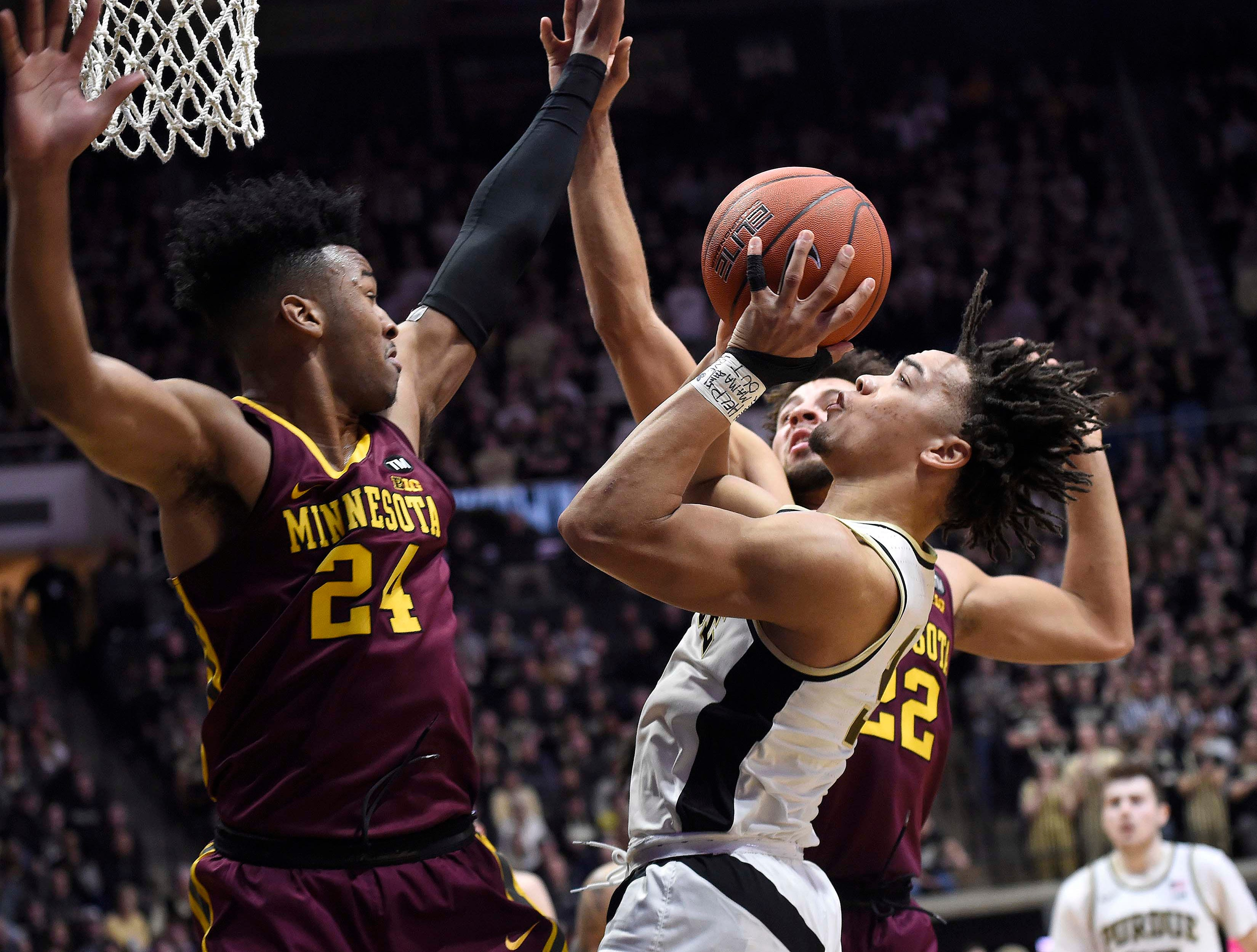 Feb 3, 2019; West Lafayette, IN, USA; Purdue Boilermakers guard Carsen Edwards (3) shoots through the defense of Minnesota Golden Gophers forward Eric Curry (24) and guard Gabe Kalscheur (22) n the 2nd half at Mackey Arena. Mandatory Credit: Sandra Dukes-USA TODAY Sports