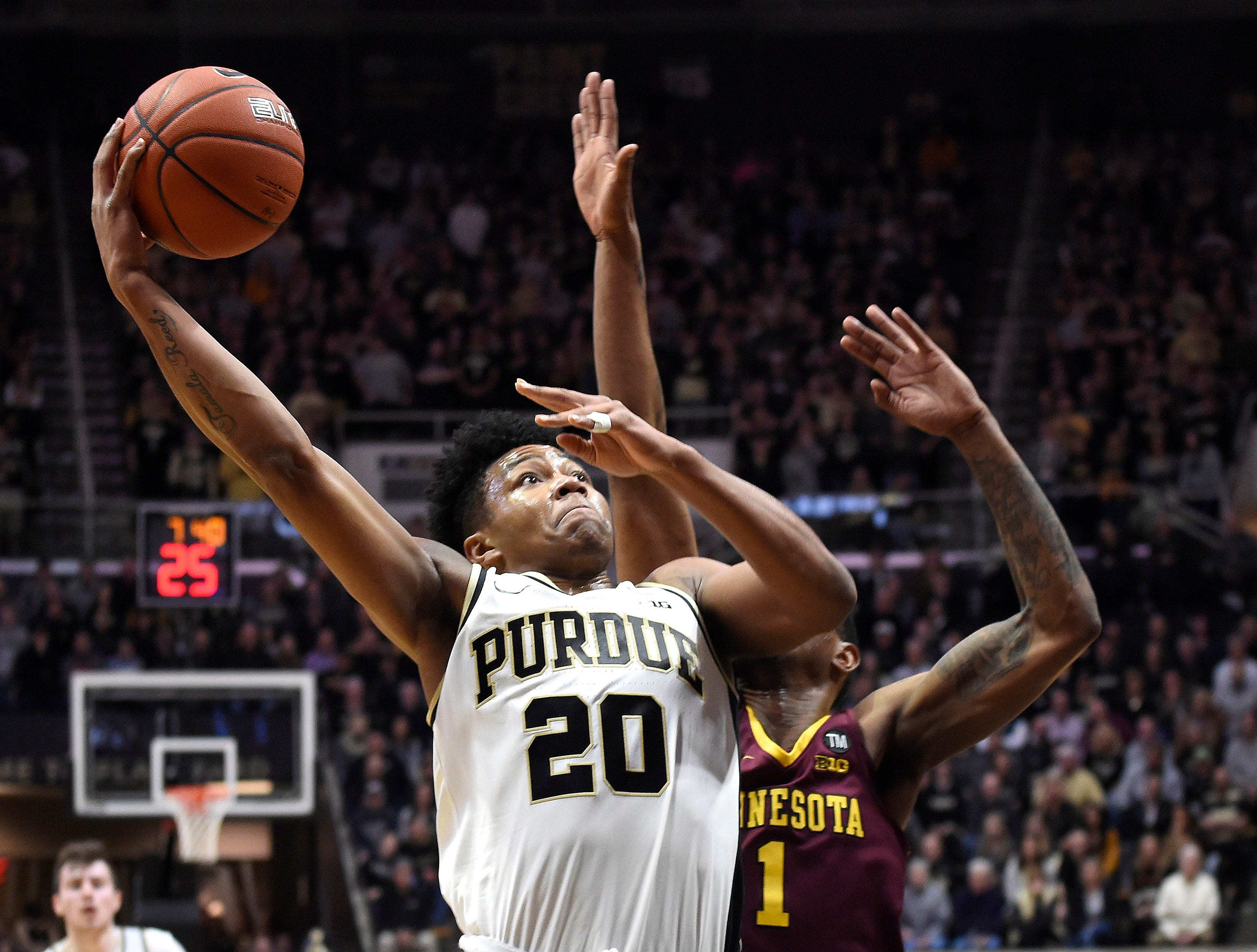 Feb 3, 2019; West Lafayette, IN, USA; Purdue Boilermakers guard Nojel Eastern (20) shoots the ball as Minnesota Golden Gophers guard Dupree McBrayer (1) defends in the first half at Mackey Arena. Mandatory Credit: Sandra Dukes-USA TODAY Sports
