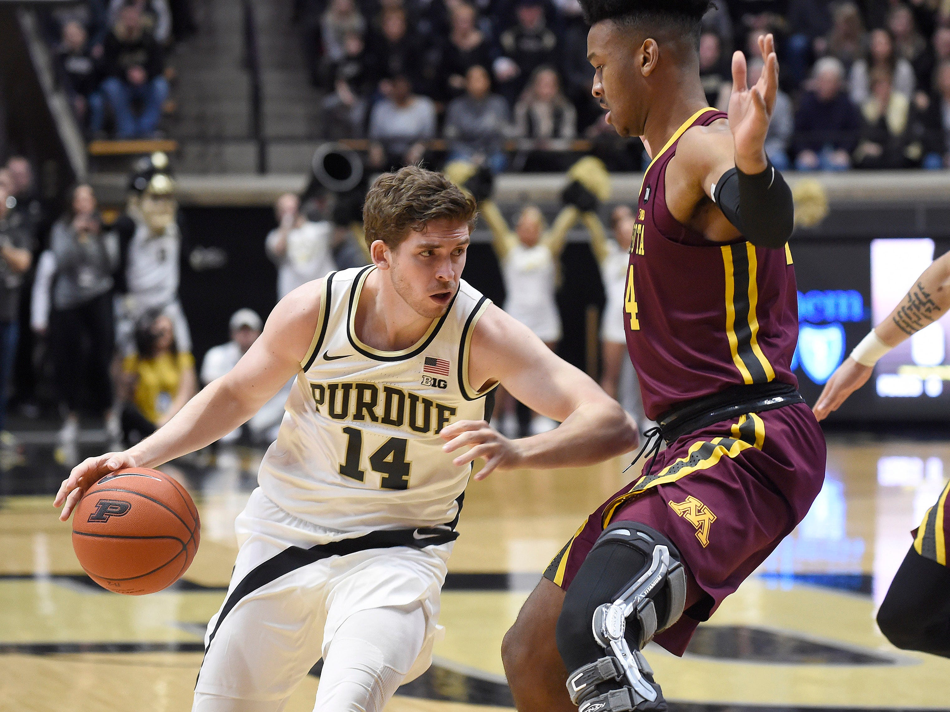 Feb 3, 2019; West Lafayette, IN, USA; Purdue Boilermakers guard Ryan Cline (14) dribbles the ball as Minnesota Golden Gophers forward Eric Curry (24) defends in the first half at Mackey Arena. Mandatory Credit: Sandra Dukes-USA TODAY Sports