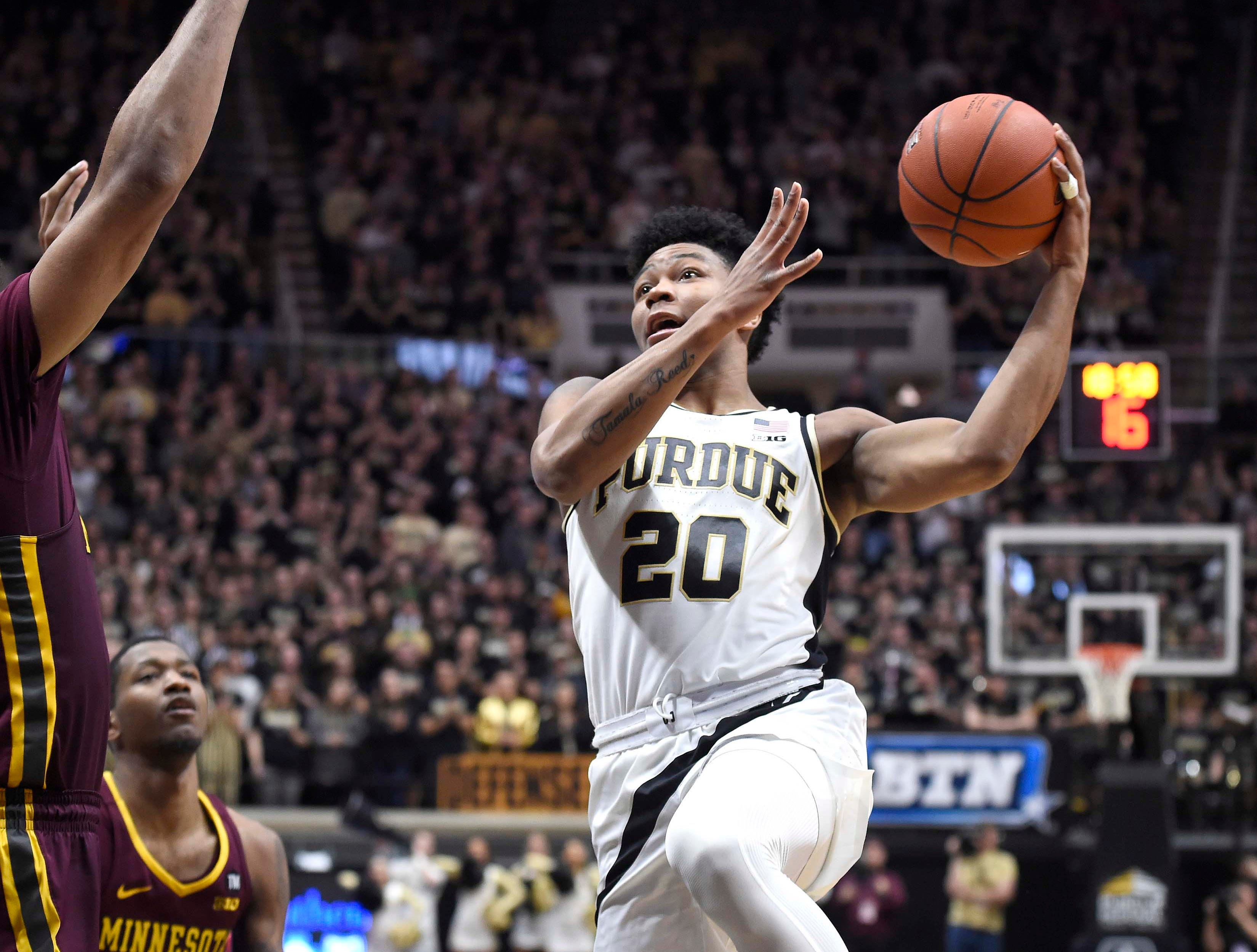 Feb 3, 2019; West Lafayette, IN, USA; Purdue Boilermakers guard Nojel Eastern (20) drives for a shot over against the Minnesota Golden Gophers defender in the 2nd half at Mackey Arena. Mandatory Credit: Sandra Dukes-USA TODAY Sports