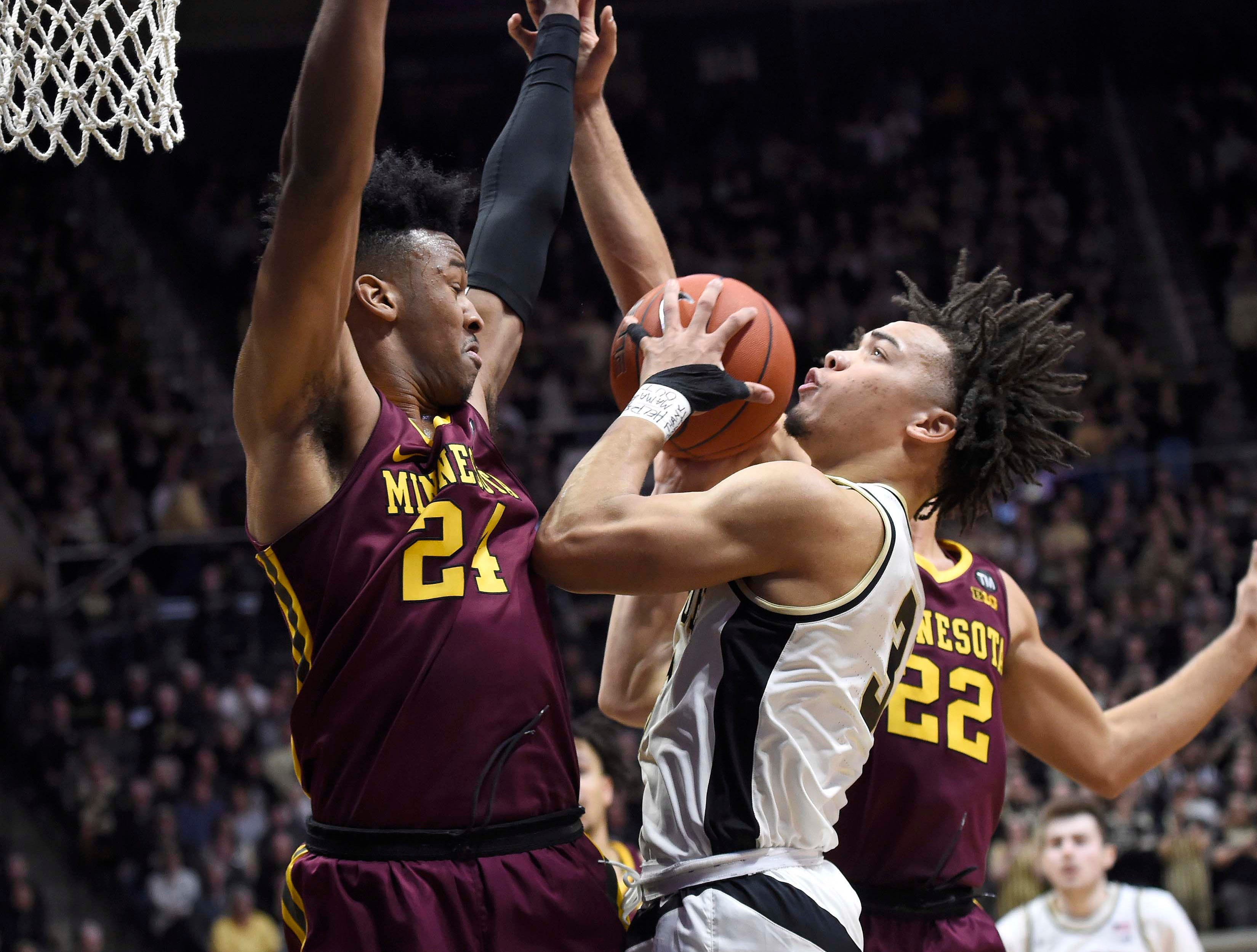 Feb 3, 2019; West Lafayette, IN, USA; iPurdue Boilermakers guard Carsen Edwards (3) shoots through the defense of Minnesota Golden Gophers forward Eric Curry (24) and guard Gabe Kalscheur (22) n the 2nd half at Mackey Arena. Mandatory Credit: Sandra Dukes-USA TODAY Sports