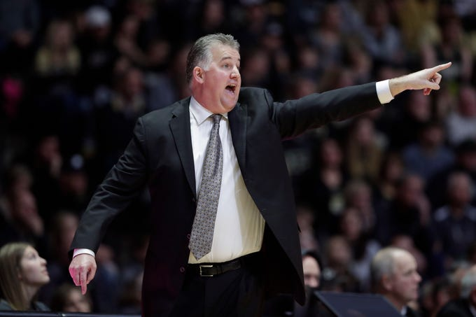 Purdue head coach Matt Painter gestures on the sideline as his team plays against Belmont during the second half of an NCAA college basketball game in West Lafayette, Ind., Saturday, Dec. 29, 2018.