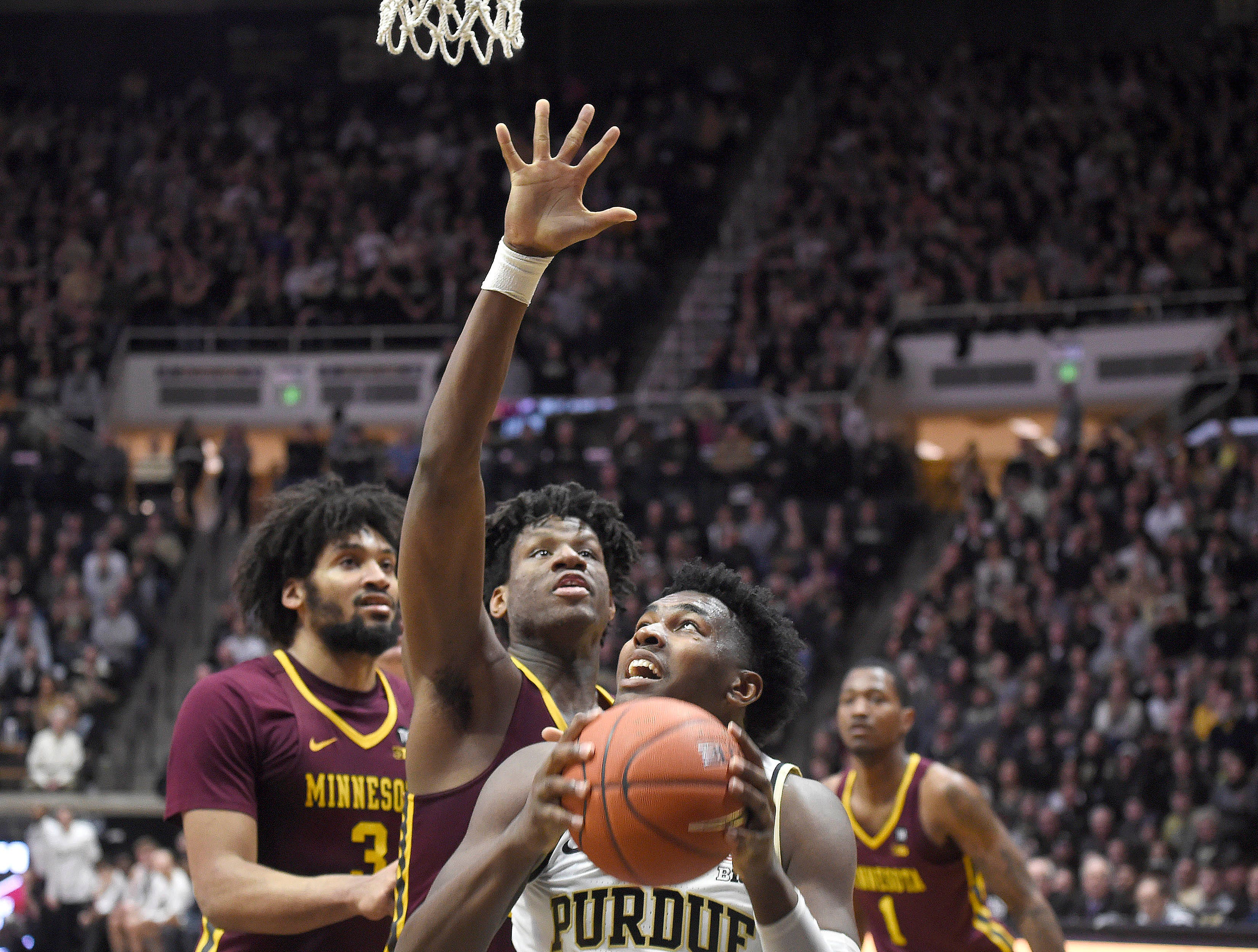 Feb 3, 2019; West Lafayette, IN, USA; Purdue Boilermakers forward Trevion Williams (50) prepares to shoot the ball as Minnesota Golden Gophers center Daniel Oturu (25) defends in the first half at Mackey Arena. Mandatory Credit: Sandra Dukes-USA TODAY Sports