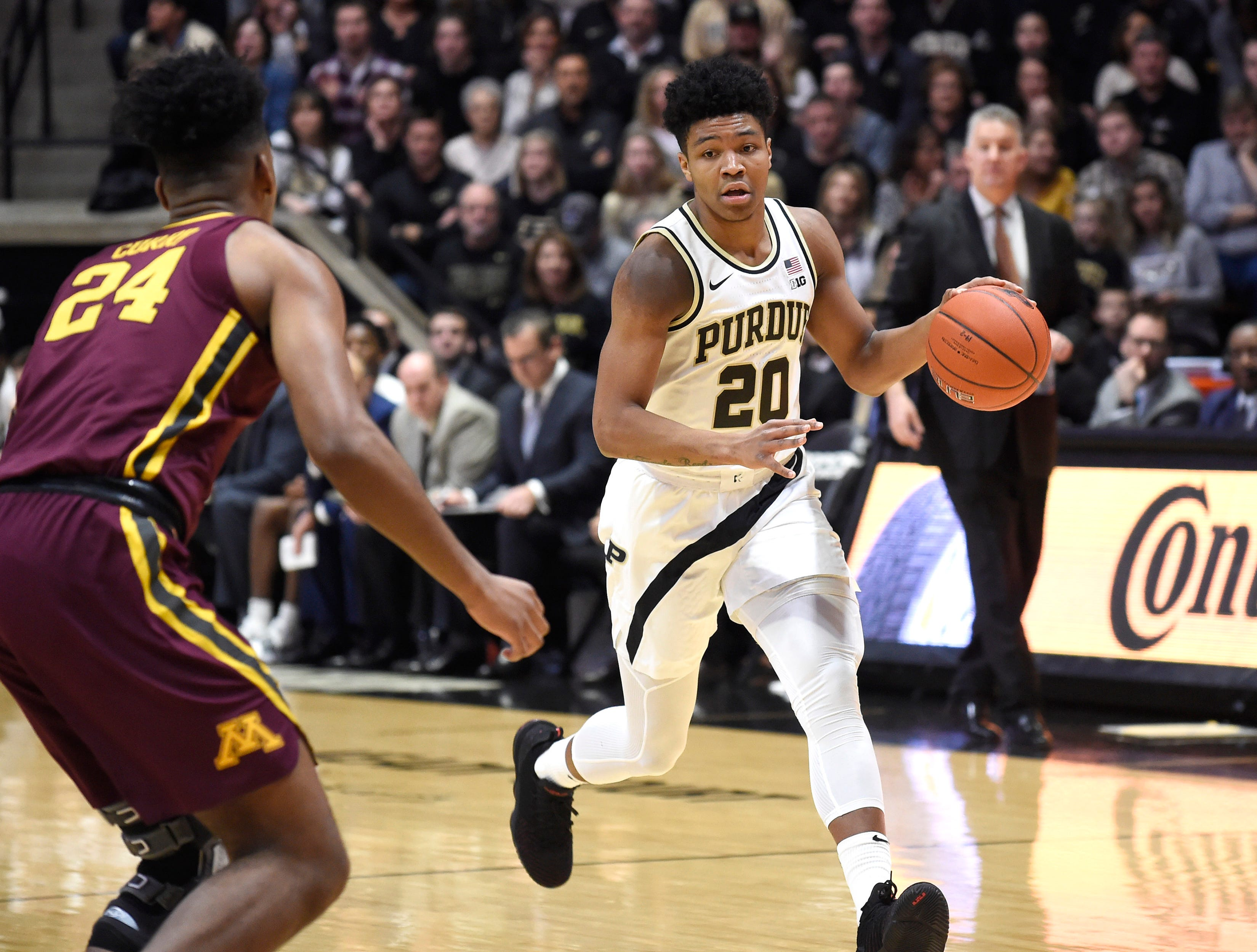 Feb 3, 2019; West Lafayette, IN, USA; Purdue Boilermakers guard Nojel Eastern (20) dribbles the ball as Minnesota Golden Gophers forward Eric Curry (24) defends in the first half at Mackey Arena. Mandatory Credit: Sandra Dukes-USA TODAY Sports