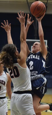Central Catholic sophomore Caroline Lutz gets a jumper off in the paint over Seeger's Avery Cole Monday night.
