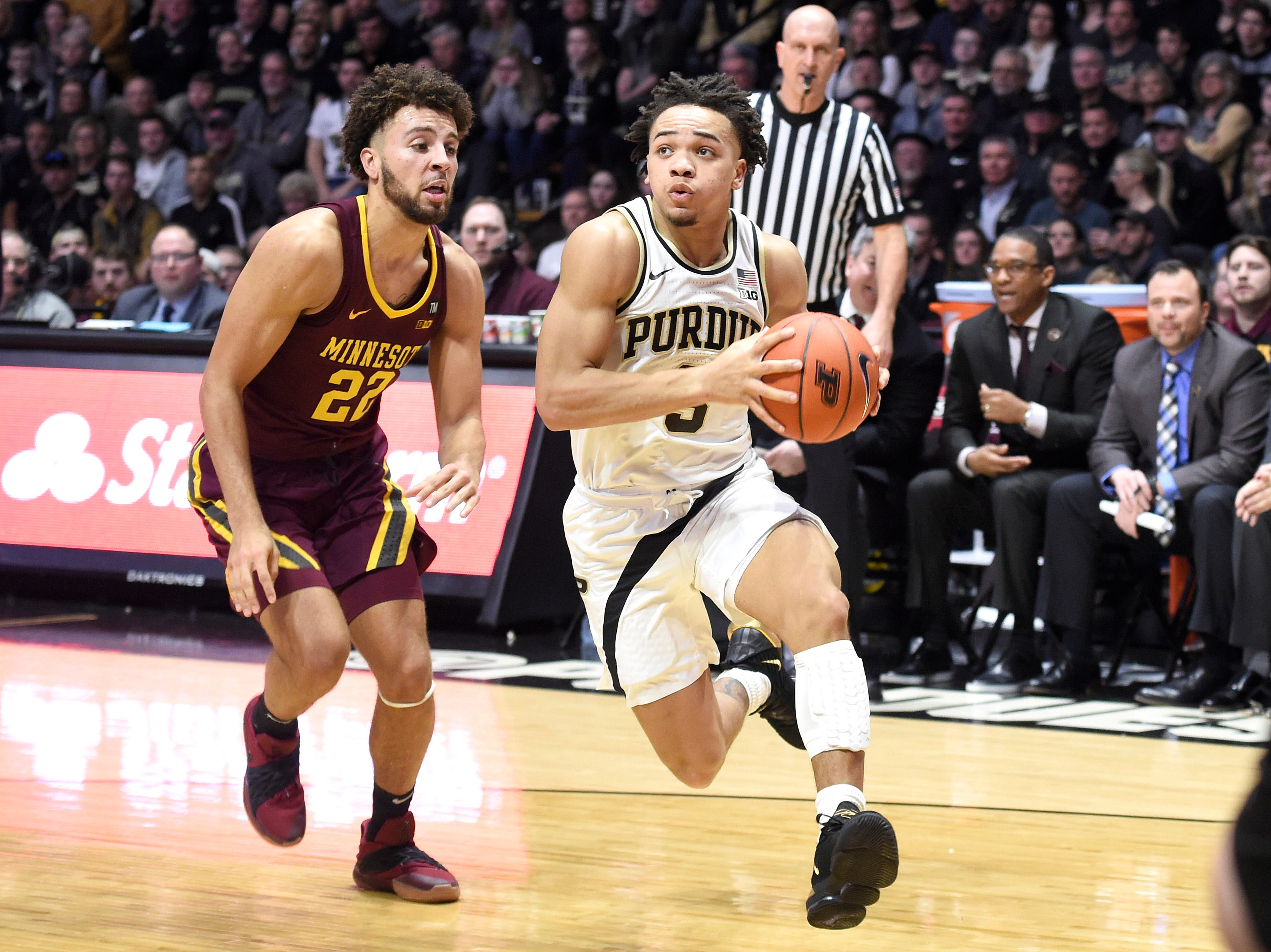 Feb 3, 2019; West Lafayette, IN, USA; Purdue Boilermakers guard Carsen Edwards (3) dribbles the ball past Minnesota Golden Gophers guard Gabe Kalscheur (22) in the first half at Mackey Arena. Mandatory Credit: Sandra Dukes-USA TODAY Sports