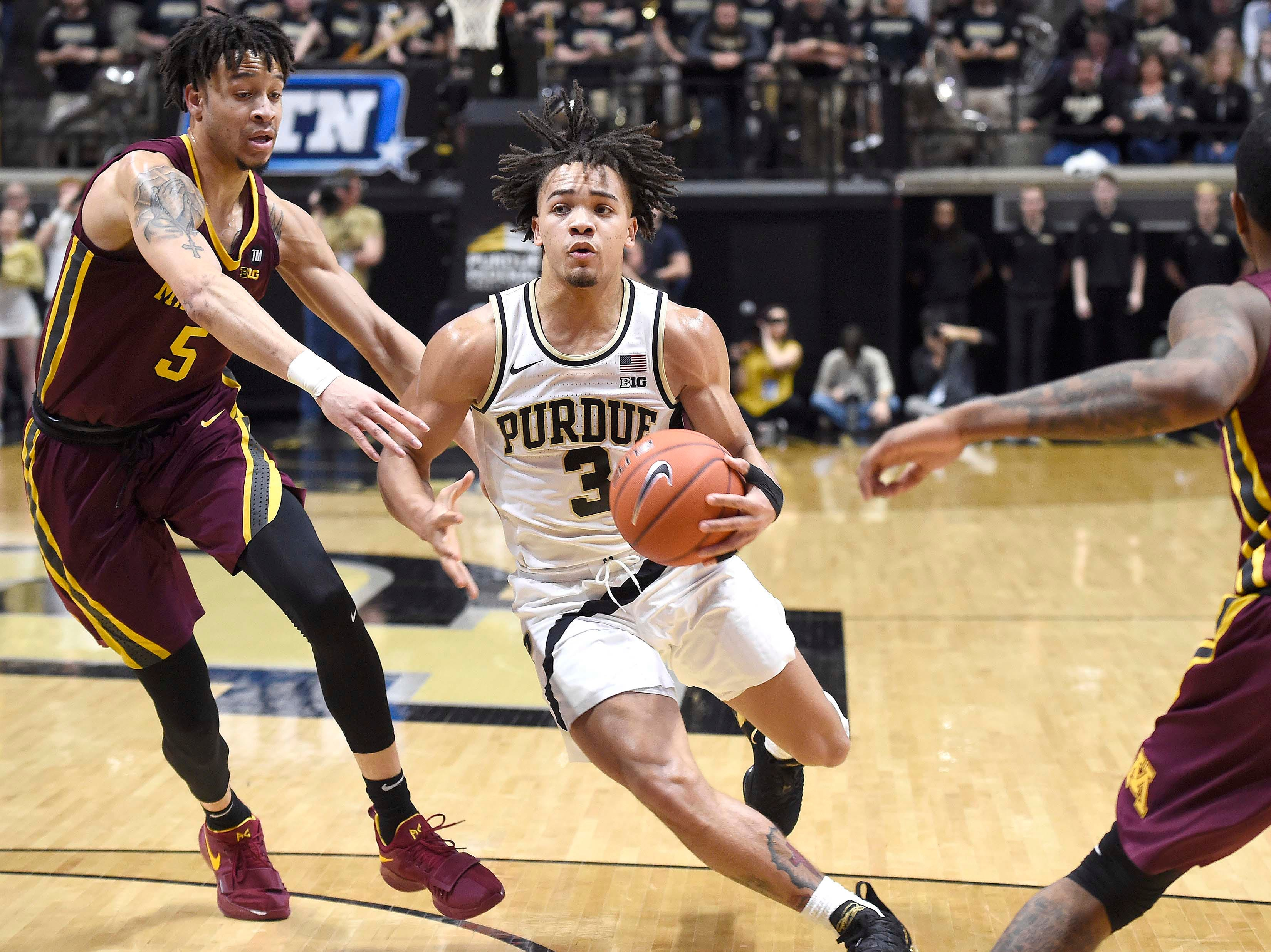 Feb 3, 2019; West Lafayette, IN, USA; Purdue Boilermakers guard Carsen Edwards (3) drives past Minnesota Golden Gophers guard Amir Coffey (5) in the 2nd half at Mackey Arena. Mandatory Credit: Sandra Dukes-USA TODAY Sports
