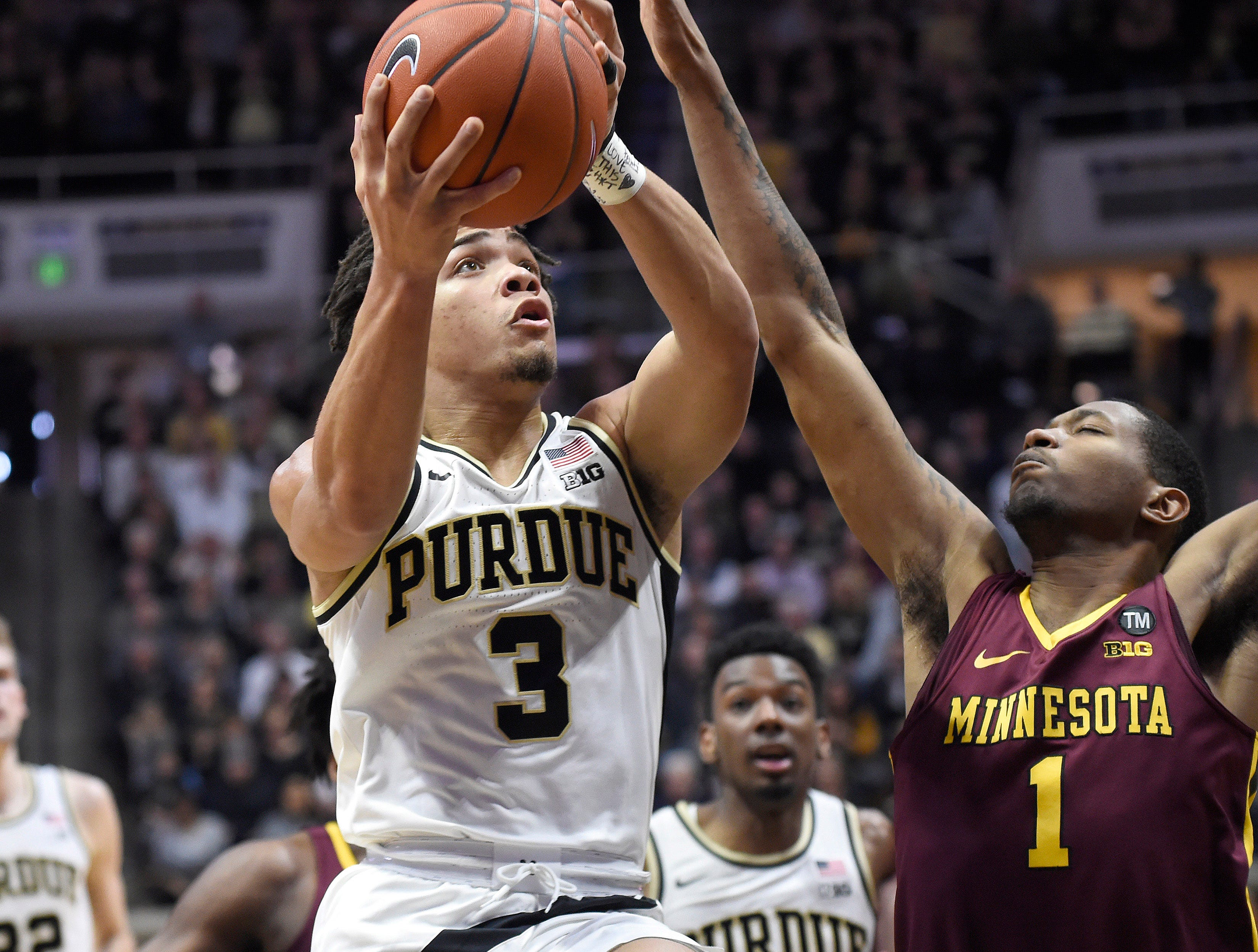 Feb 3, 2019; West Lafayette, IN, USA; Purdue Boilermakers guard Carsen Edwards (3) shoots the ball as Minnesota Golden Gophers guard Dupree McBrayer (1) defends in the first half at Mackey Arena. Mandatory Credit: Sandra Dukes-USA TODAY Sports