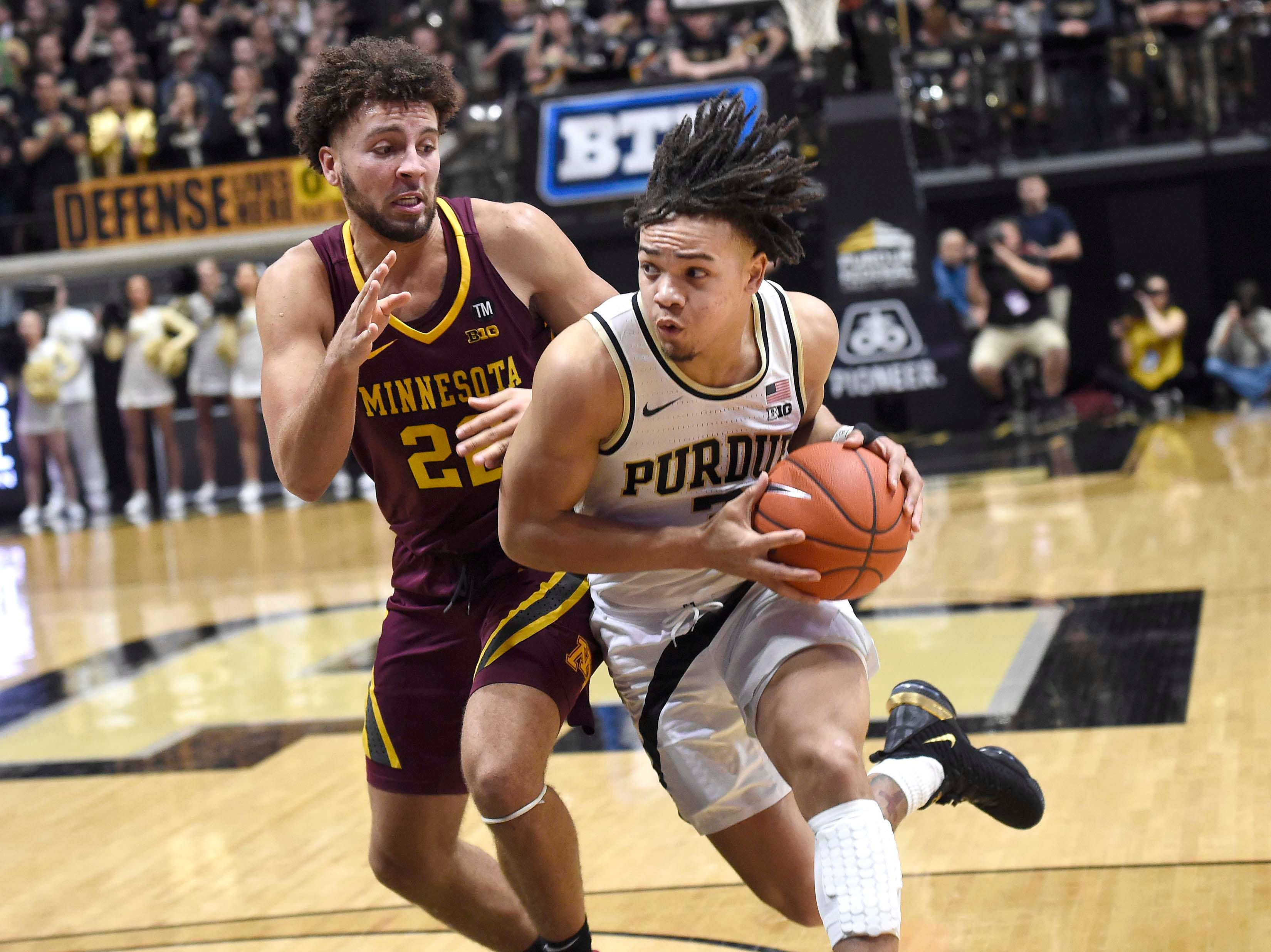 Feb 3, 2019; West Lafayette, IN, USA; Purdue Boilermakers guard Carsen Edwards (3) drives past Minnesota Golden Gophers guard Gabe Kalscheur (22) in the 2nd half at Mackey Arena. Mandatory Credit: Sandra Dukes-USA TODAY Sports