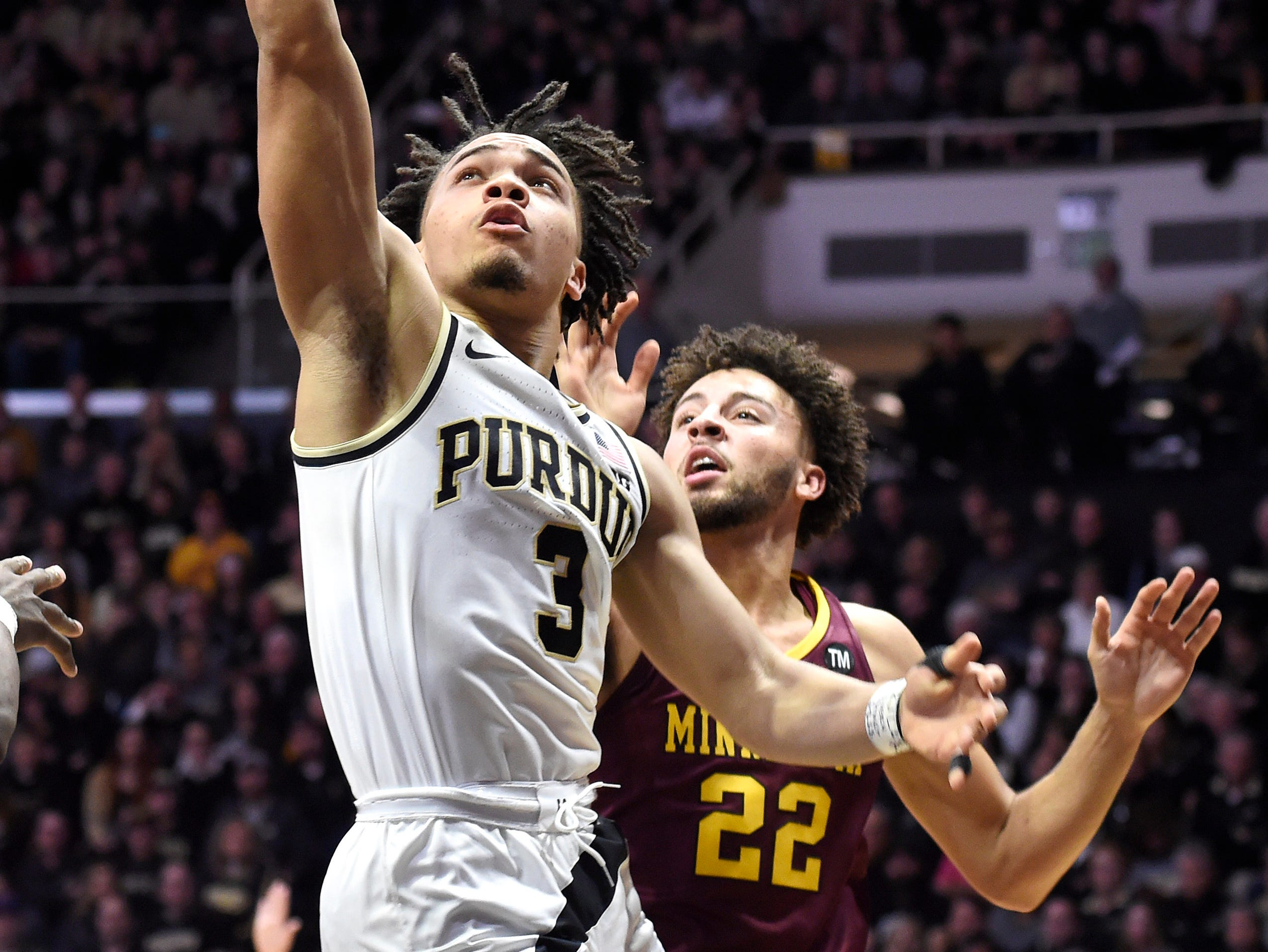 Feb 3, 2019; West Lafayette, IN, USA; Purdue Boilermakers guard Carsen Edwards (3) shoots the ball past Minnesota Golden Gophers guard Gabe Kalscheur (22) in the first half at Mackey Arena. Mandatory Credit: Sandra Dukes-USA TODAY Sports