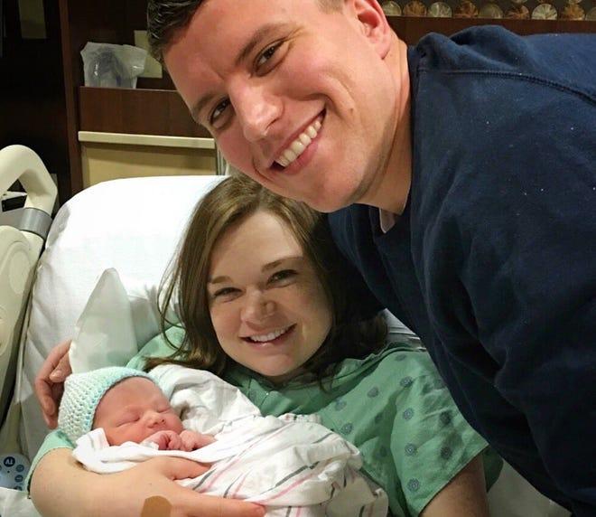 New parents, Kayla Sullivan and Allan Heiden, hold Allan Eugene Heiden, who was born Saturday, Feb. 2.