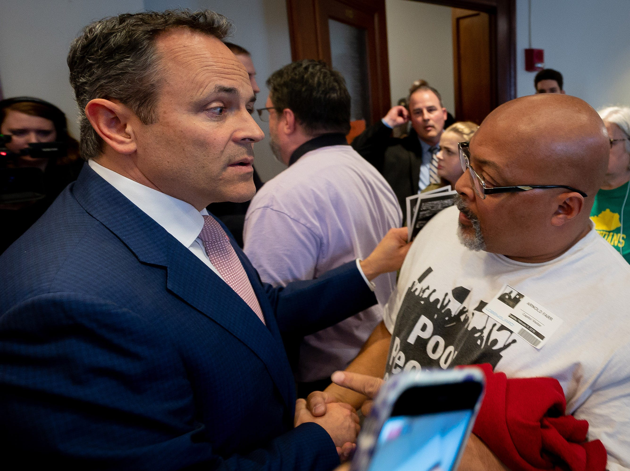 Gov. Matt Bevin shakes the hand of Arnold Farr after meeting with members of the Kentucky Poor People's Campaign at the Capitol building in Frankfort, Ky, Tuesday, Feb. 5, 2018