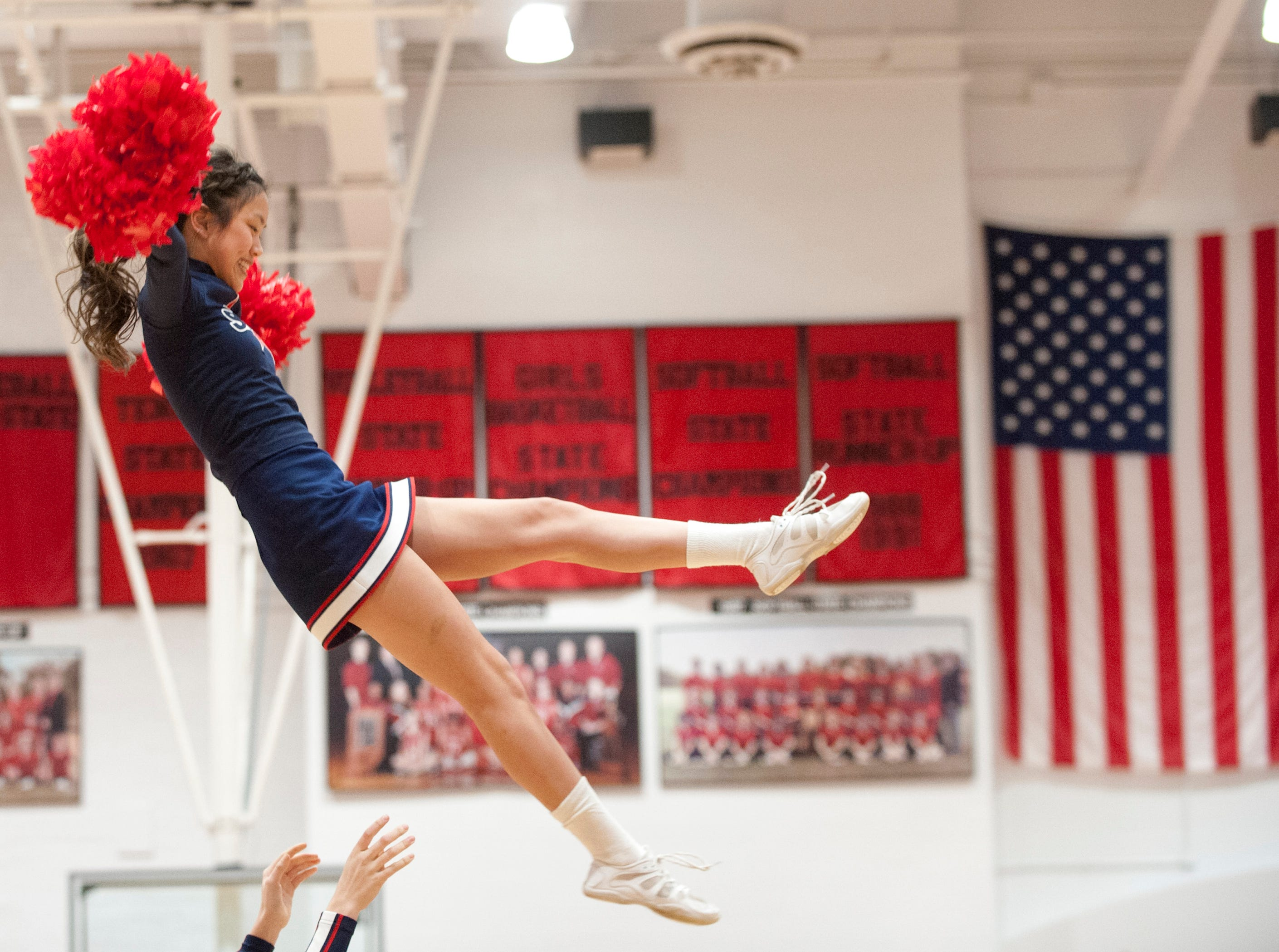 A Bedford North Lawrence cheerleader is tossed high into the air.04 February 2019