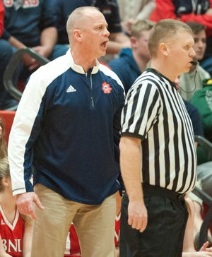 Bedford North Lawrence head basketball coach Jeff Allen yells instructions to his team on the floor during the game.