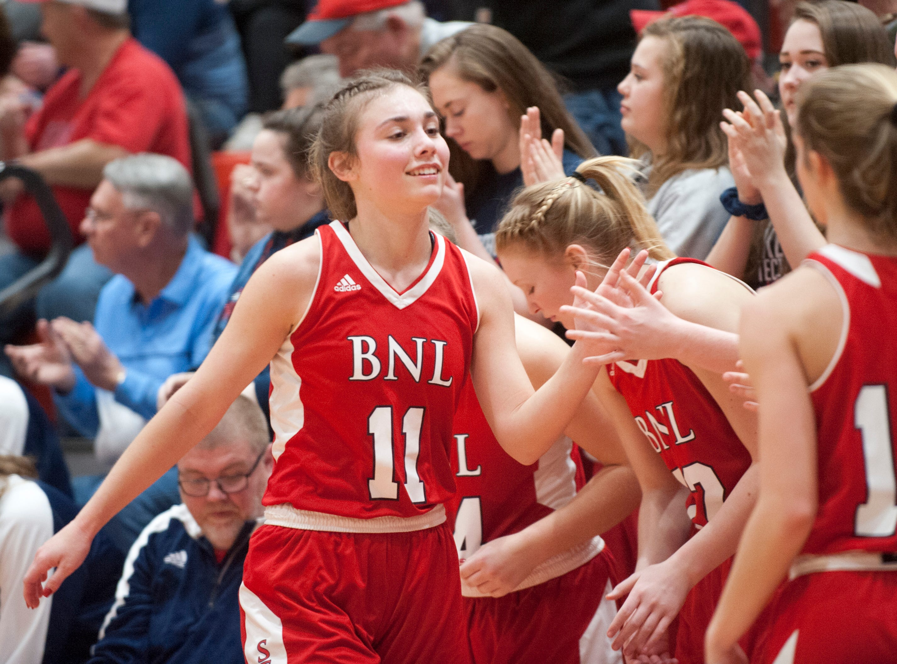 Bedford North Lawrence forward Chloe Mcknight is congratulated by her teammates as she comes out of the game.04 February 2019