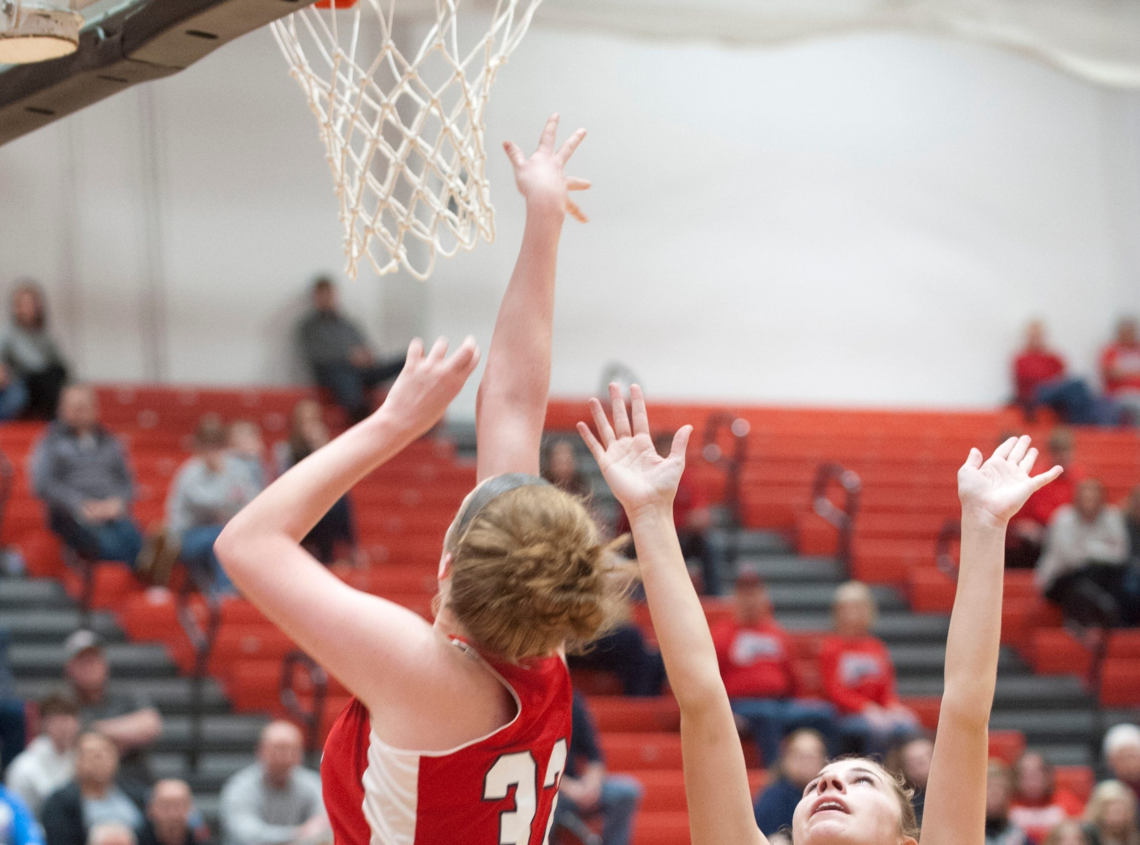 Bedford North Lawrence center Madison Webb puts a shot up as Jennings County center-forward Callie Wilder defends the basket.04 February 2019