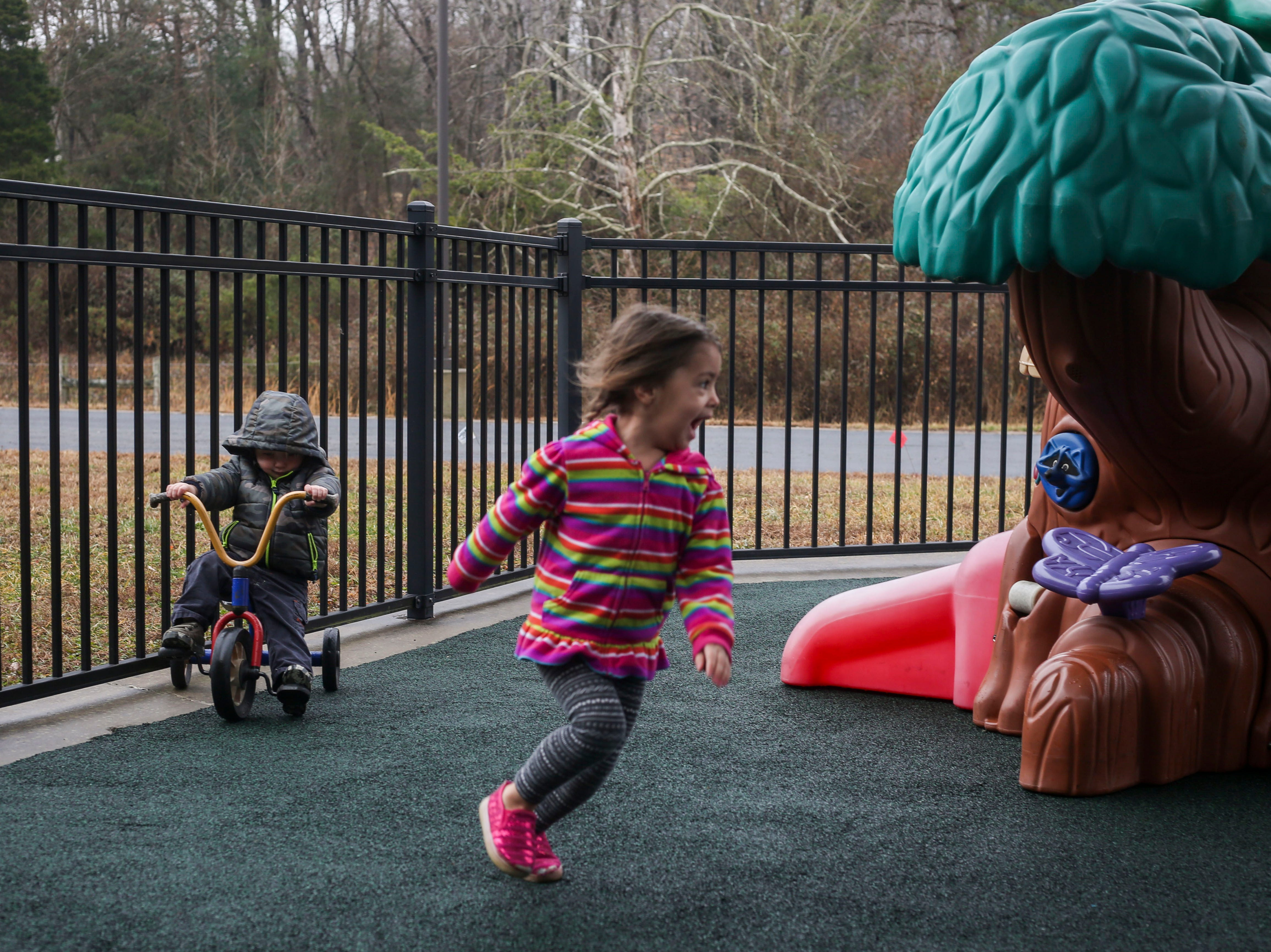 Claire Dupree, right, plays outdoors during the Early Head Start program at Brooks Elementary School in Brooks, Kentucky, on Feb. 5, 2019.