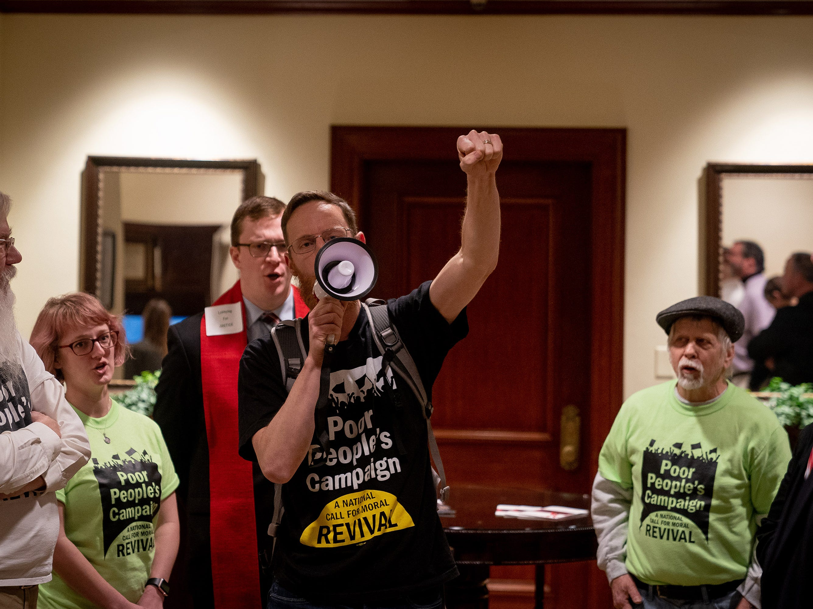 Members of the Kentucky's Poor People's Campaign gather and refuse to leave the office of Governor Matt Bevin in the Capitol building in Frankfort, Ky, Tuesday, Feb. 5, 2018.  The group left after the Governor agreed to meet with the group later that afternoon.