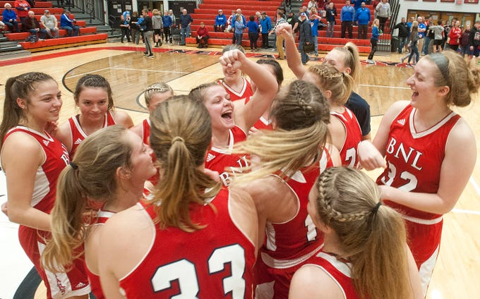 The Bedford North Lawrence girls basketball team celebrates moments after defeating Jennings County in the IHSAA New Albany Sectional Championship 56-34.05 February 2019