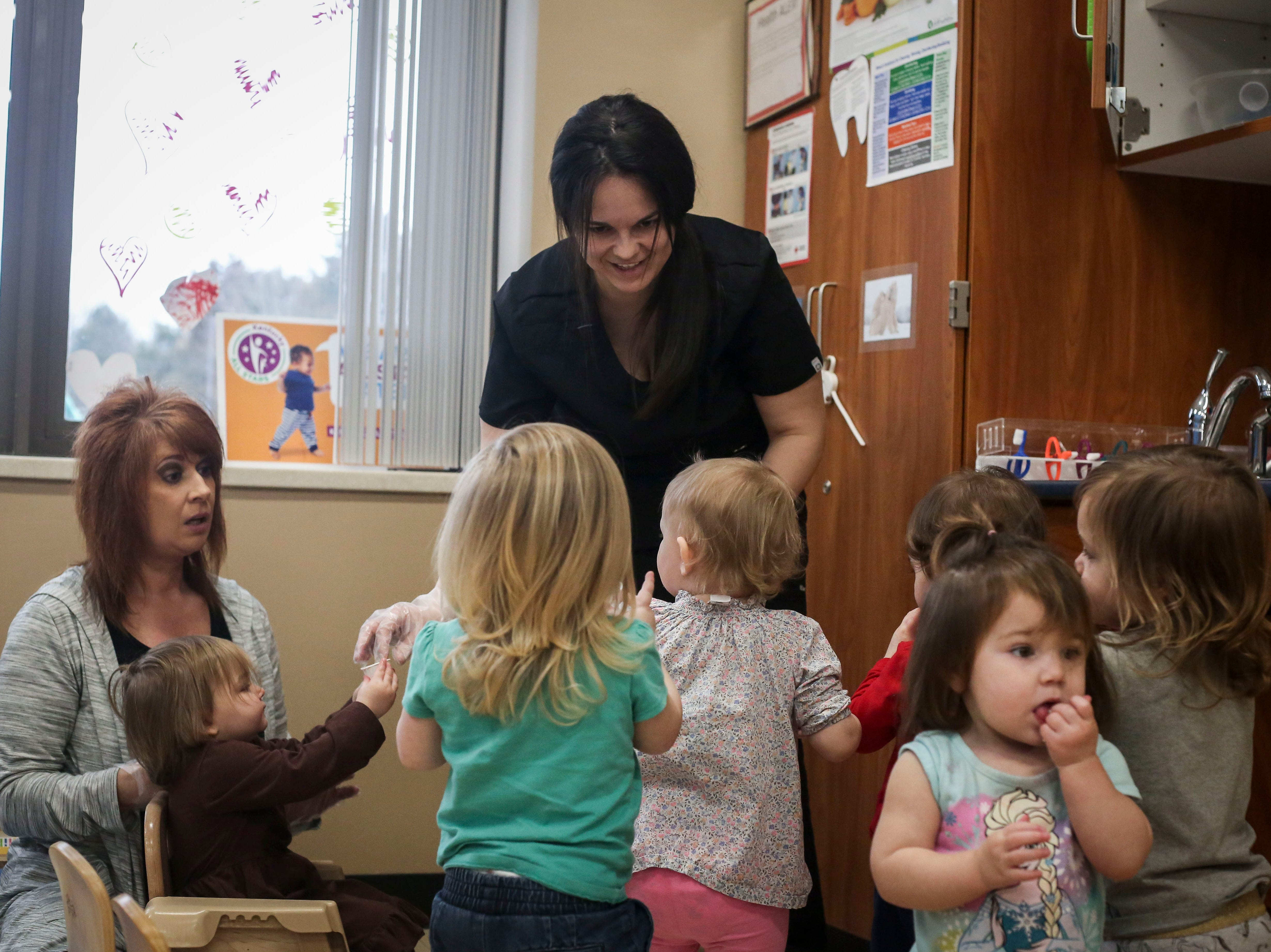 Stephanie Wright, primary caregiver, helps children brush their teeth during the Early Head Start program at Brooks Elementary School in Brooks, Ky. on Feb. 5, 2019.