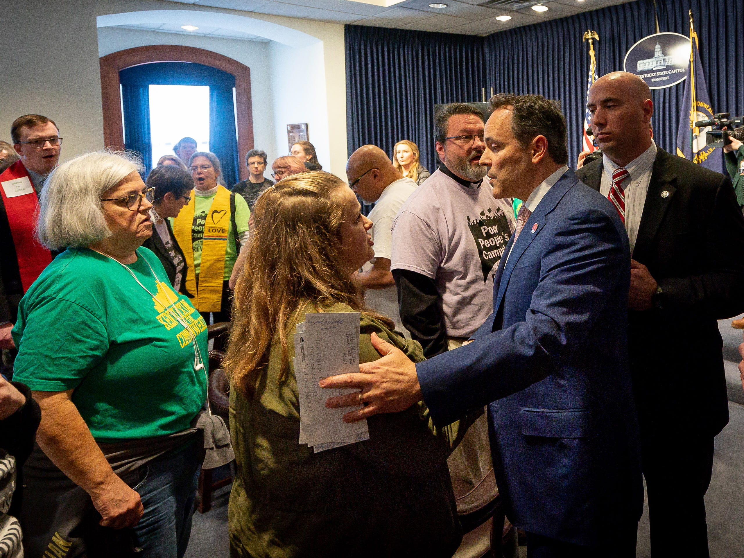 Gov. Matt Bevin greets members of the Kentucky Poor People's Campaign at the Capitol building in Frankfort, Ky, Tuesday, Feb. 5, 2018