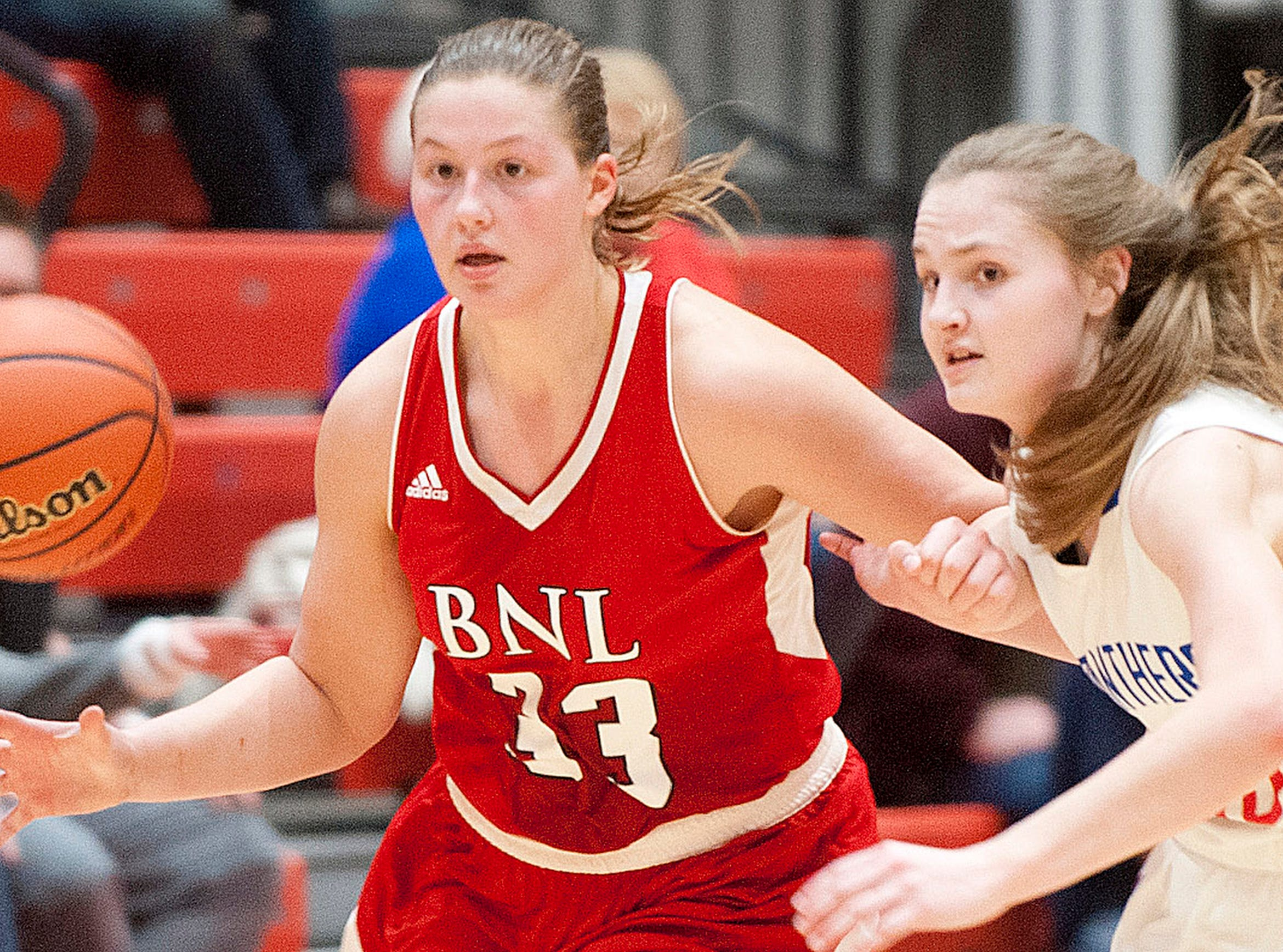 Bedford North Lawrence forward Jorie Allen and Jennings County guard-forward Lily Ernstes chase a loose ball.04 February 2019