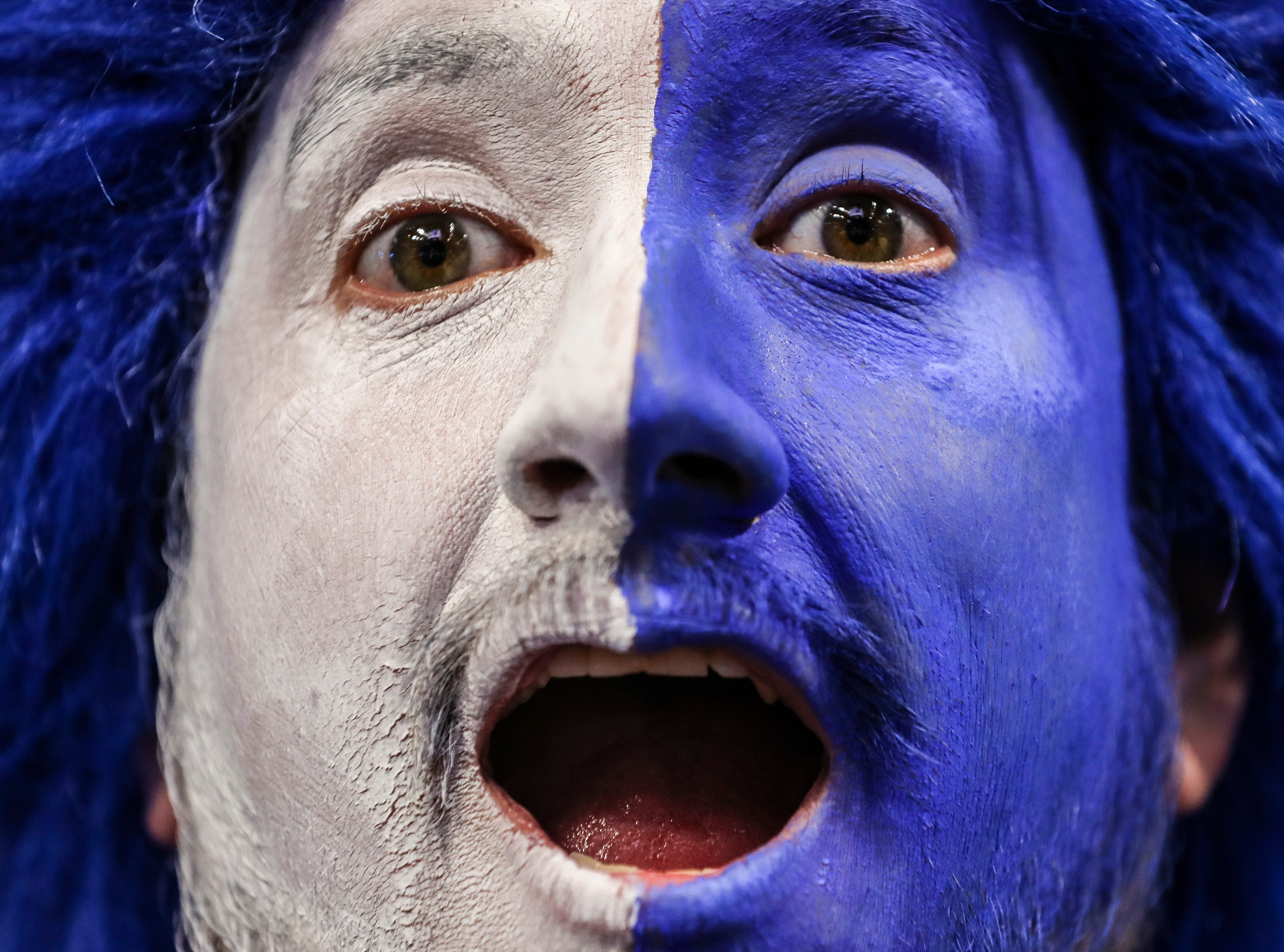 Kentucky fan Josh Henry is painted up for the game against South Carolina Tuesday night at Rupp Arena. Feb. 5, 2019