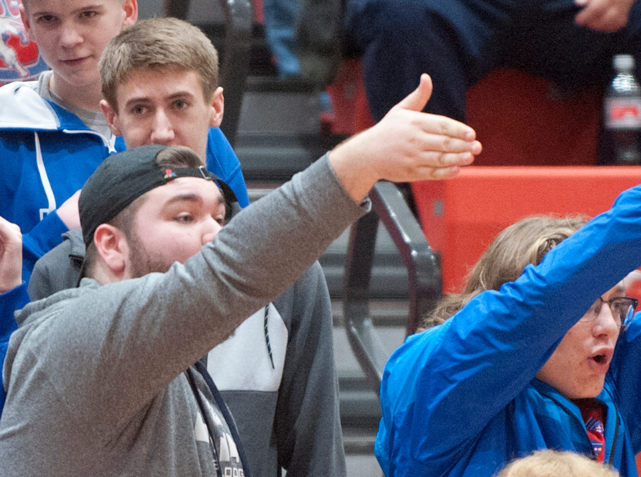 Jennings County fans tease a Bedford North Lawrence player after the player fouled.04 February 2019