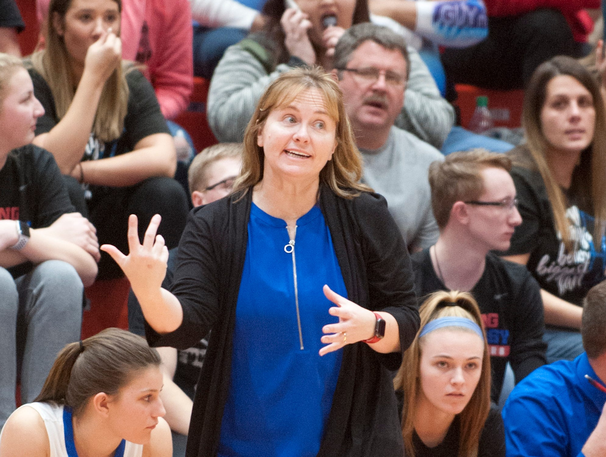 Jennings County head basketball coach Kristi Sigler signals her players on the court.04 February 2019