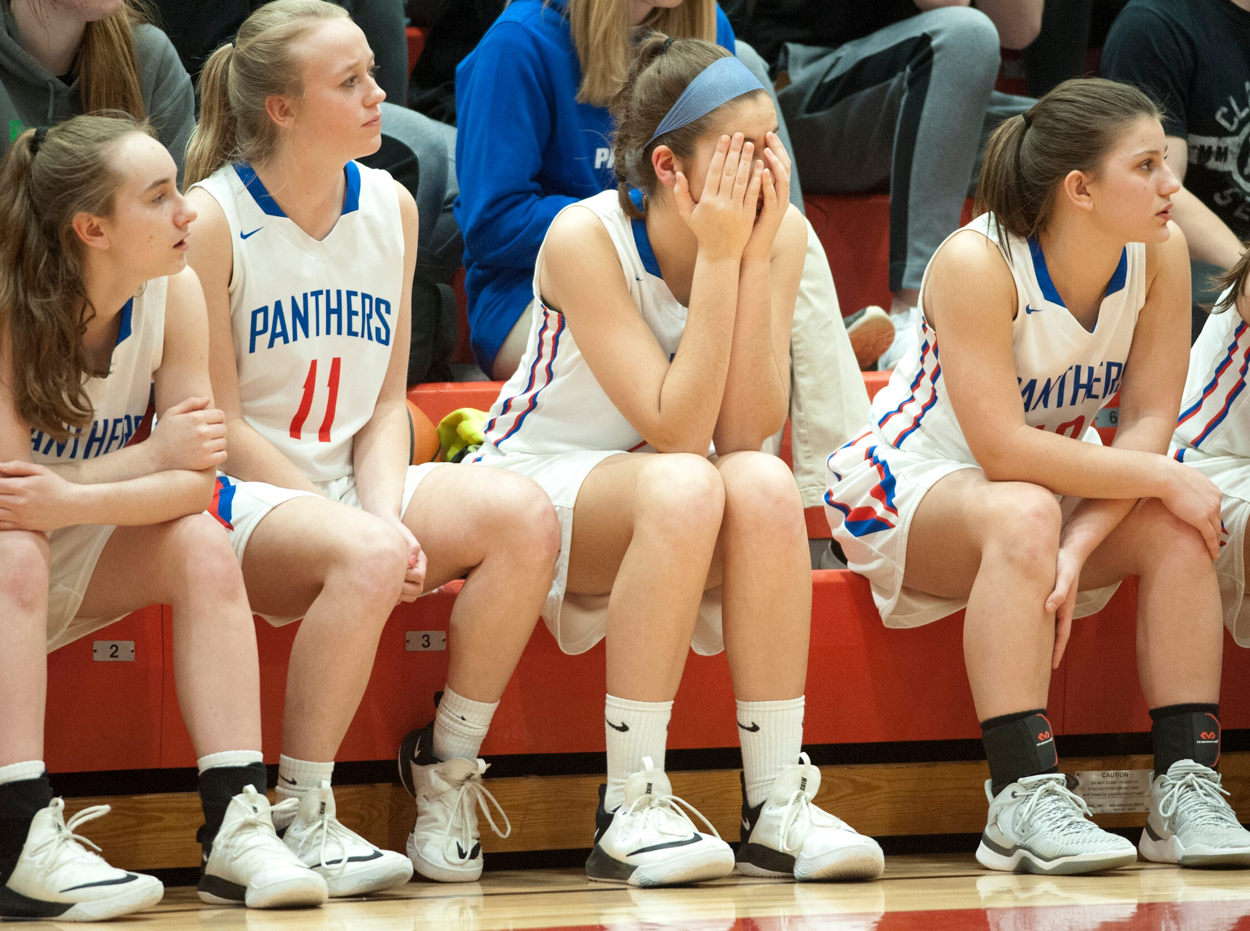 Jennings County center Grace Ramey, center, reacts as Bedford North Lawrence pulls away in the game IHSAA New Albany Sectional Championship. BNL won the contest, 56-34.05 February 2019