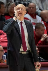 Louisville head coach Chris Mack yells to his players during the second half of an NCAA college basketball game, Monday, Feb. 4, 2019, in Blacksburg, Va. Louisville won 72-64. (AP Photo/Don Petersen)