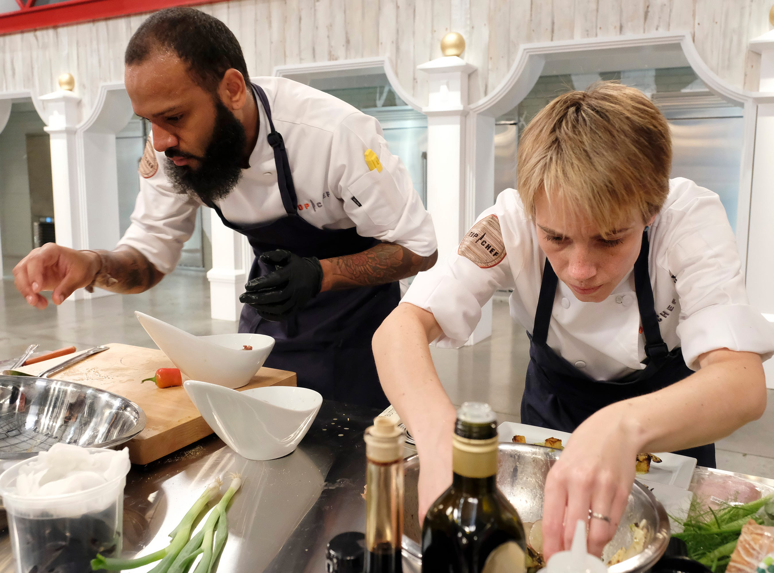 Contestants Justin Sutherland and Adrienne Wright in the kitchen during a quickfire challenge on episode 10 of Bravo's 'Top Chef: Kentucky' season.