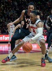 Louisville guard Khwan Fore, right, drives against Virginia Tech Hokies forward Kerry Blackshear Jr., left, during the first half of an NCAA college basketball game Monday, Feb. 4, 2019, in Blacksburg, Va.