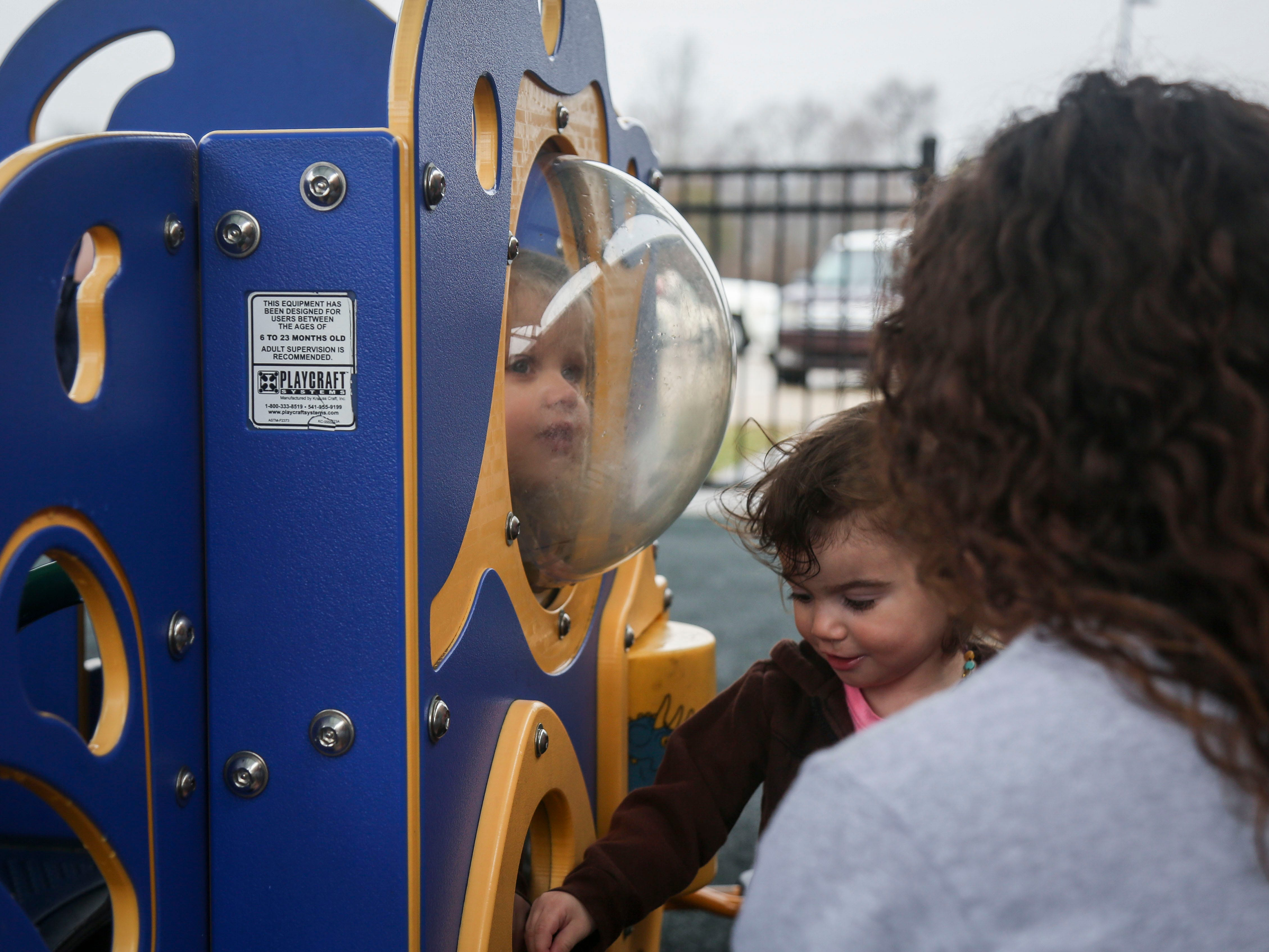 Gabriella Greenwell, Instructional and Family Services Manager of OVEC Bullitt County Head Start/Early Head Startt, plays with Hadley Caulk, middle, during outdoor playtime in the Early Head Start program at Brooks Elementary School in Brooks, Ky. on Feb. 5, 2019.