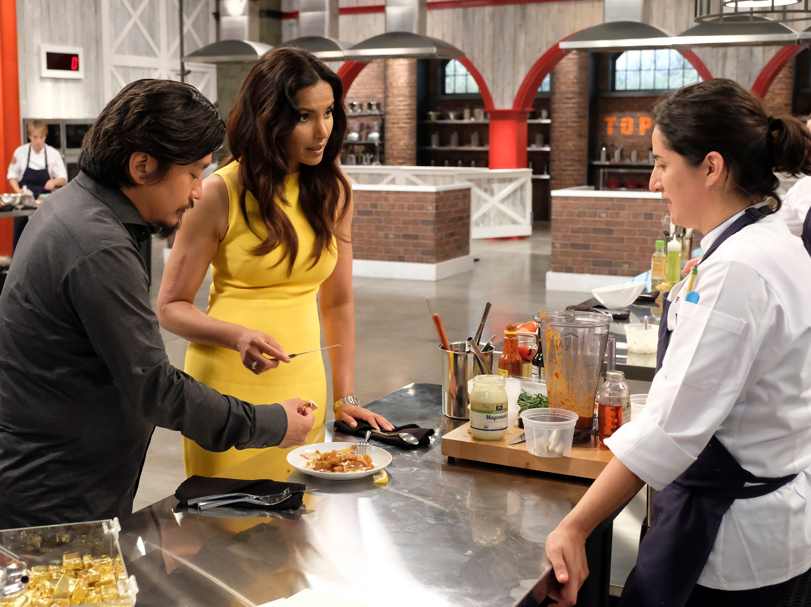 (From left to right): Louisville chef and 'Top Chef' alum Ed Lee, and Host Padma Lakshmi taste Michelle Minori's dish on episode 10 of Bravo's 'Top Chef: Kentucky' season.