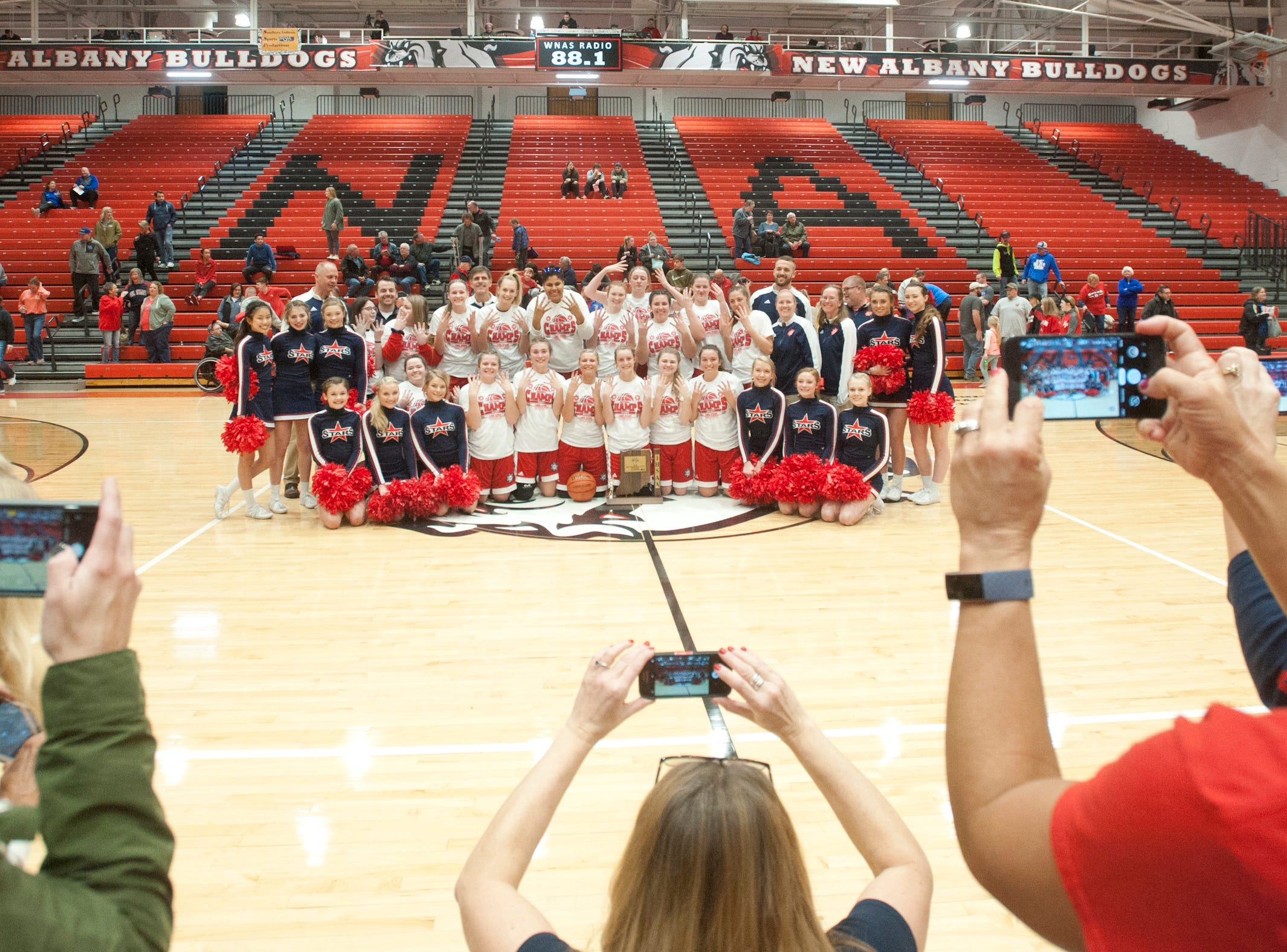After the game, friends and family shoot the Bedford North Lawrence team and their trophy.03 February 2019