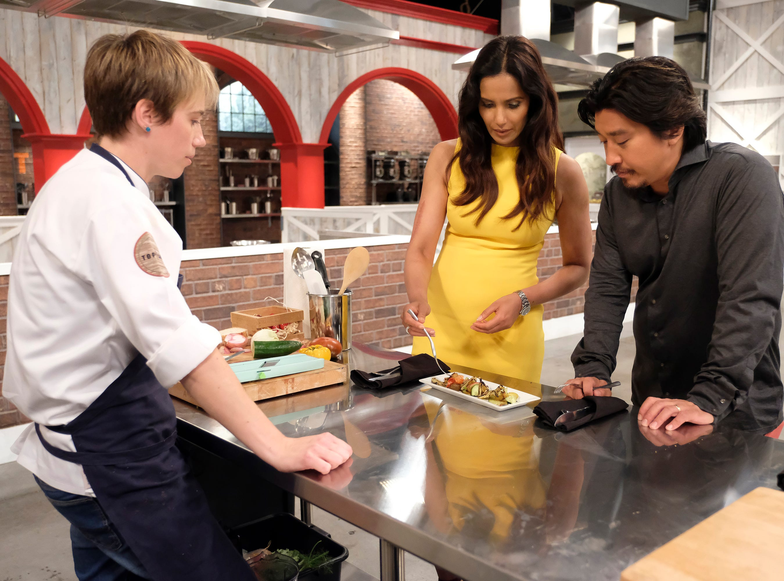 (From left to right): Contestant Adrienne Wright waits for freedback fromhost  Padma Lakshmi and Louisville chef and 'Top chef' alum Ed Lee on episode 10 of Bravo's 'Top Chef: Kentucky' season.