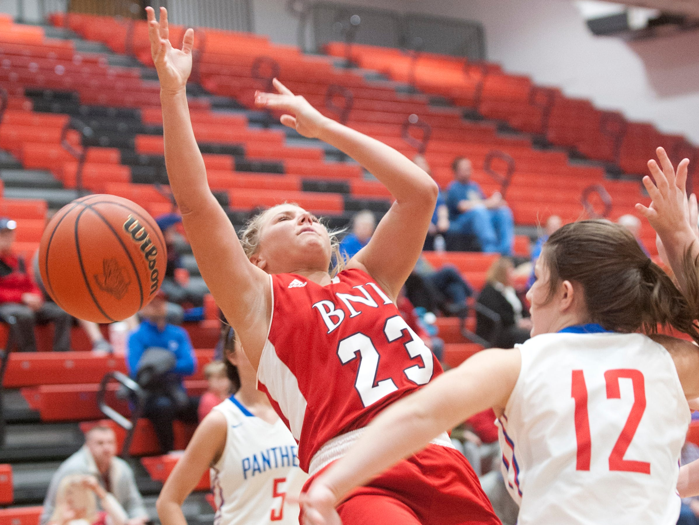 Bedford North Lawrence guard Jenna Louden collides with Jennings County guard Megan Schuler as Louden heads to the basket. Schuler was called for the blocking foul.04 February 2019