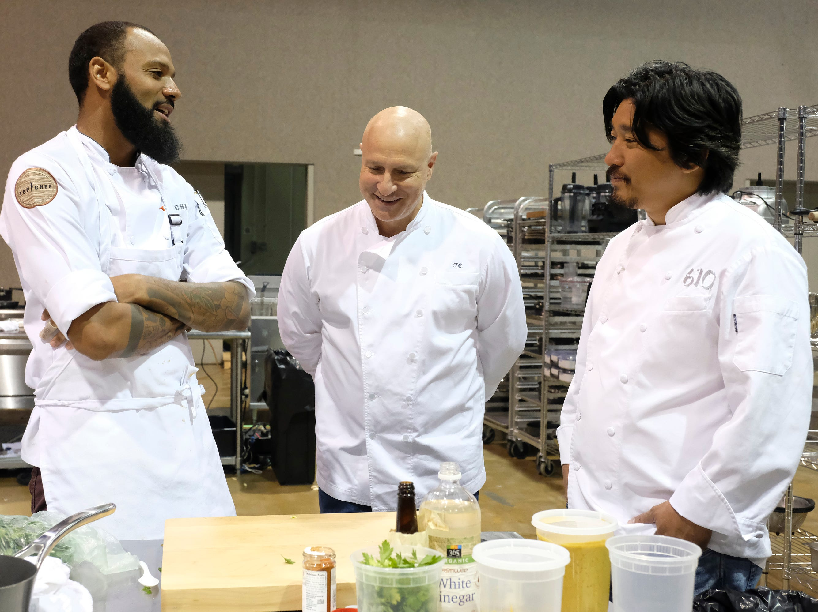 (From left to right): Contestant Justin Sutherland talks to judge Tom Colicchio and Louisville chef and 'Top Chef' alum Ed Lee on episode 10 of Bravo's 'Top Chef: Kentucky' season.